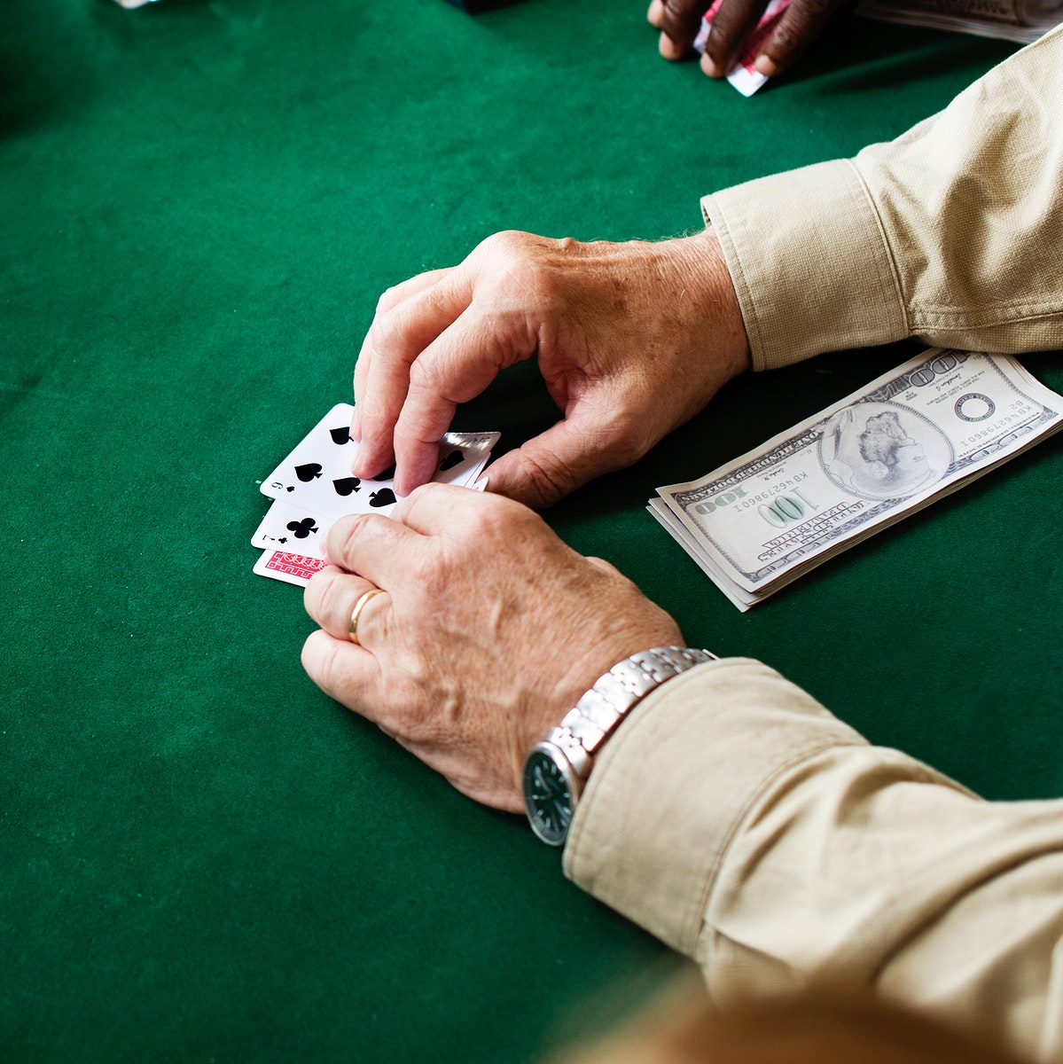Adults socialising and playing cards