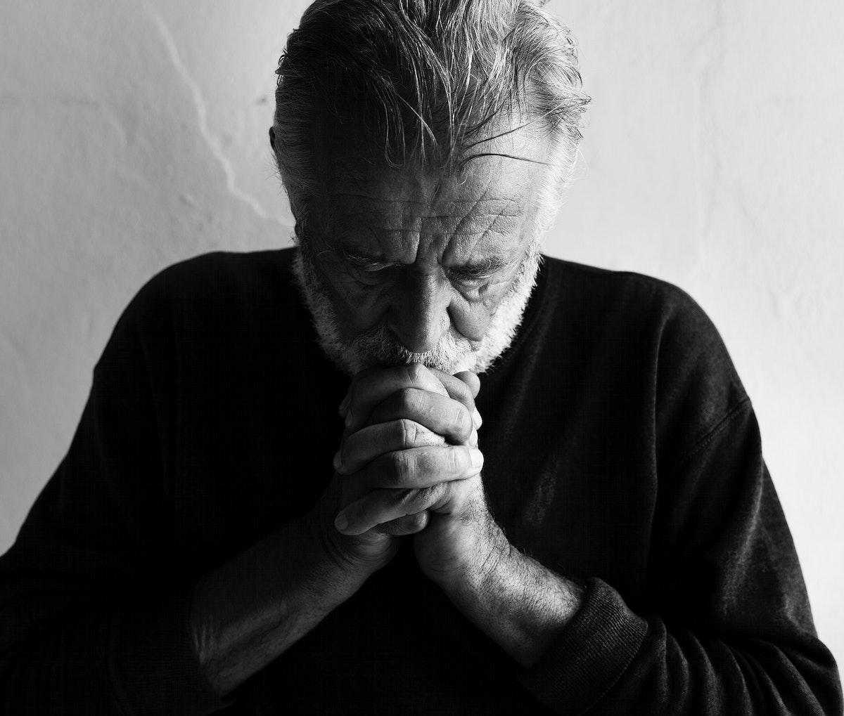 Elderly caucasian man with interlocked fingers