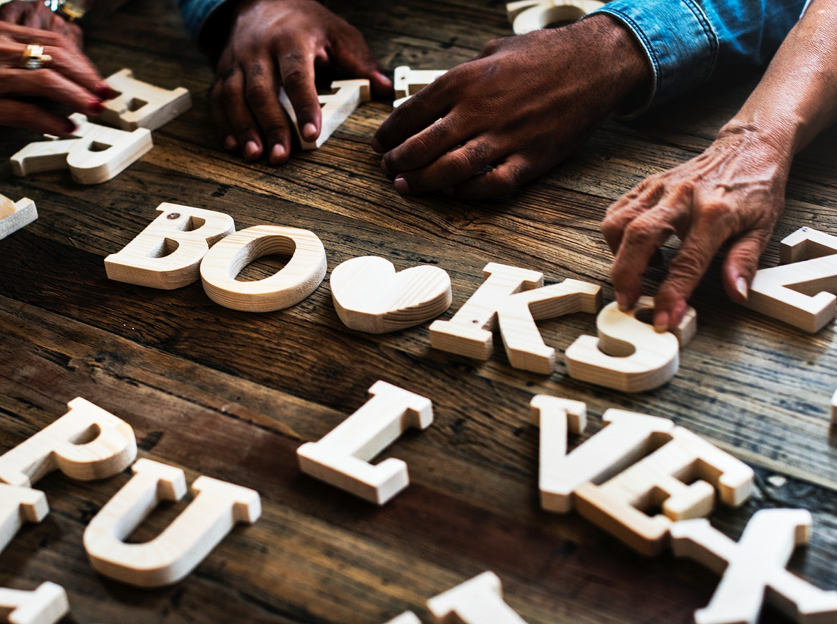 Diverse hands spell out books