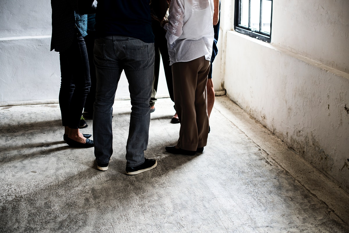 Group of adults standing in a circle