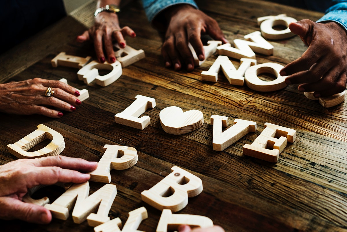 Diverse hands spelling out love