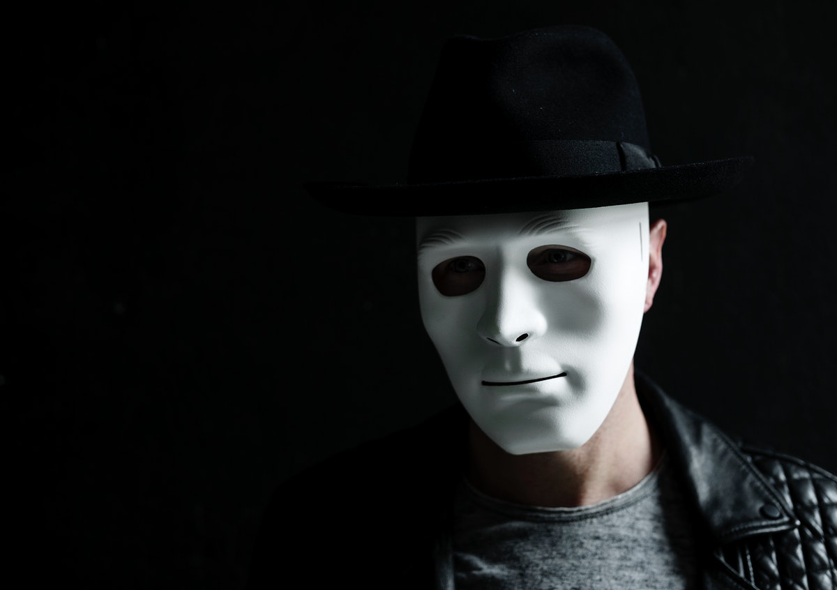 Person wearing white mask anonymous