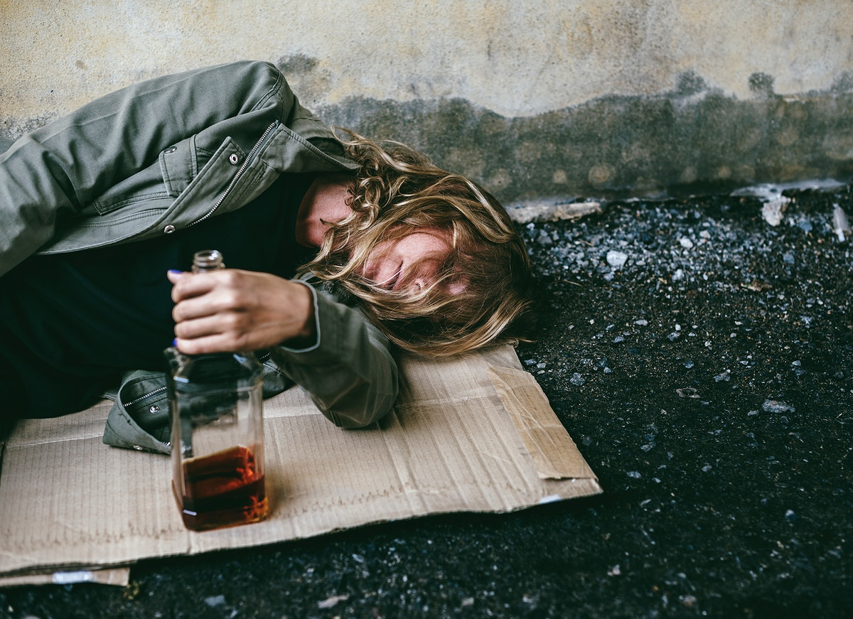 Drunk homeless man sleeping on the street