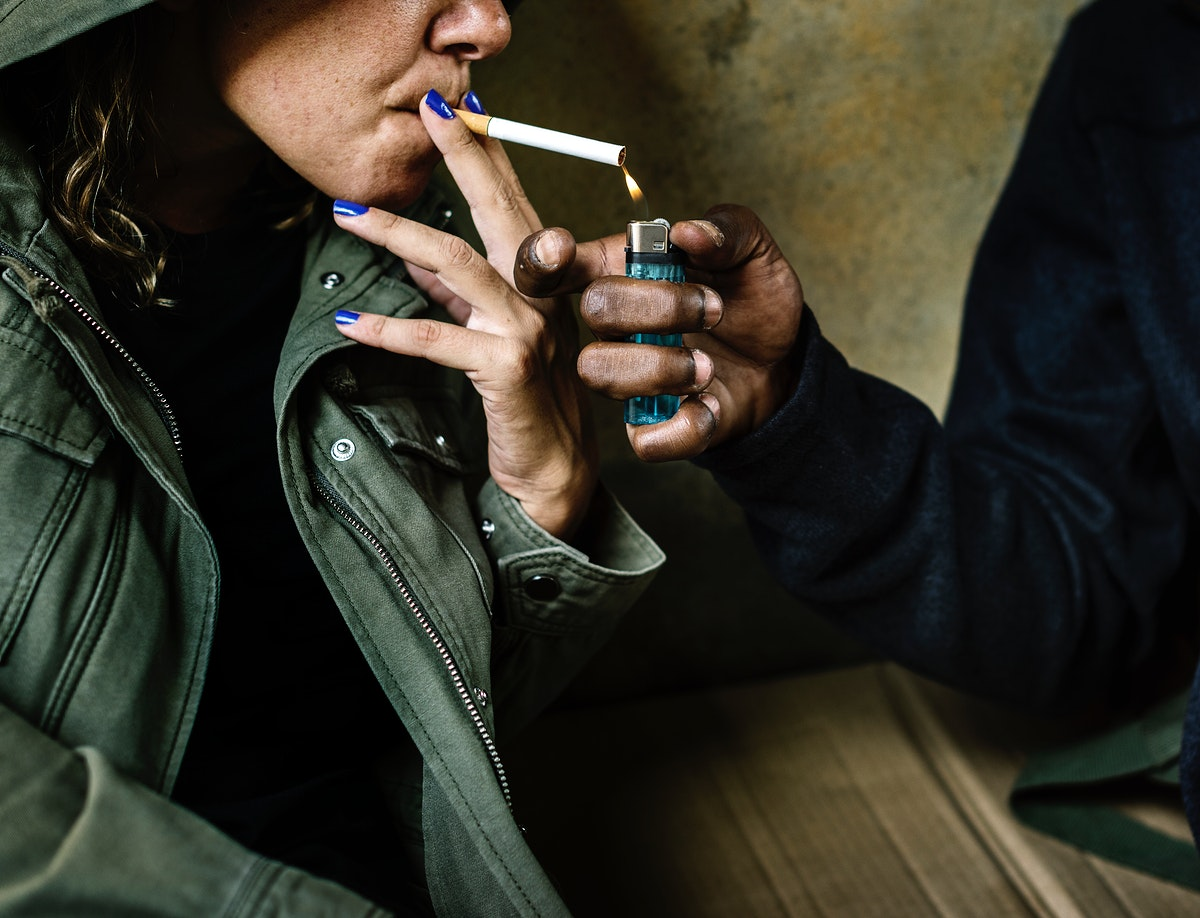 Woman getting her cigarette lit