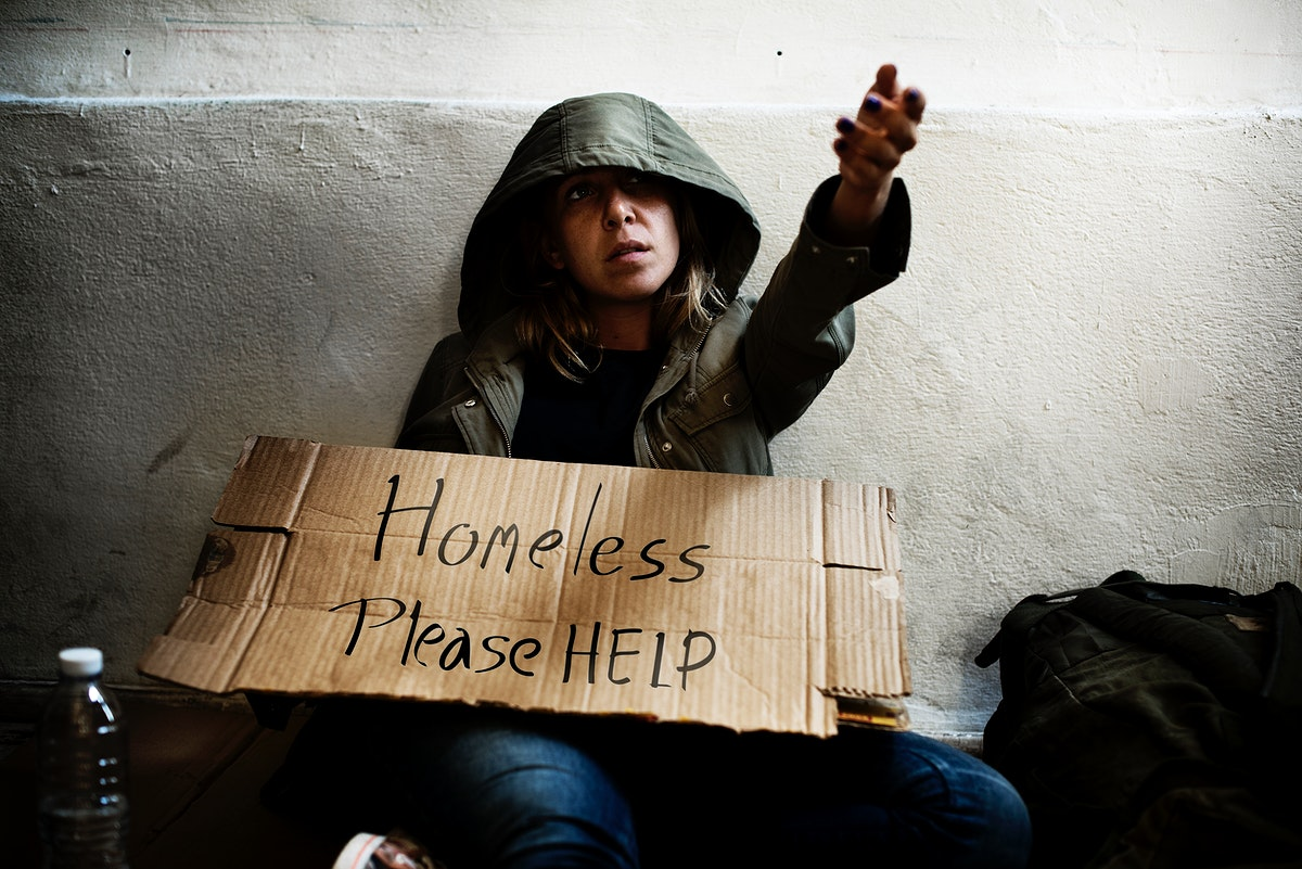Homeless woman asking for help