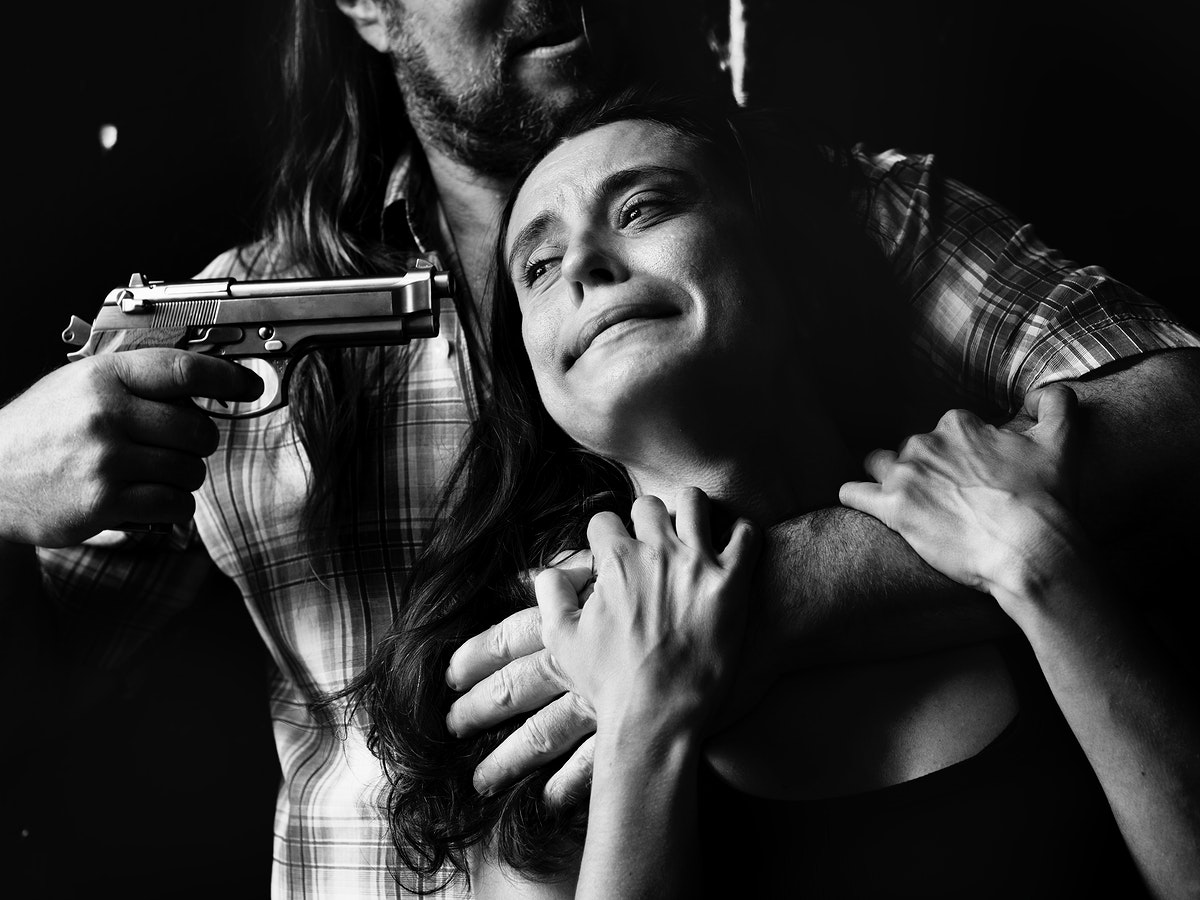 Man holding a woman hostage
