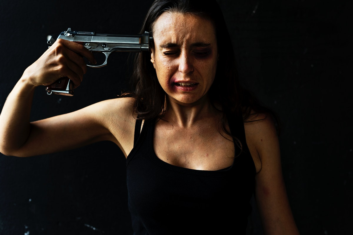 Suicidal woman holding a gun to her temple