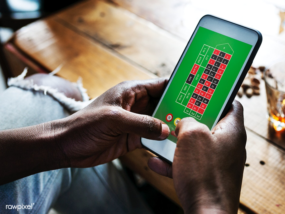Download premium image of Playing games on mobile phone 50224