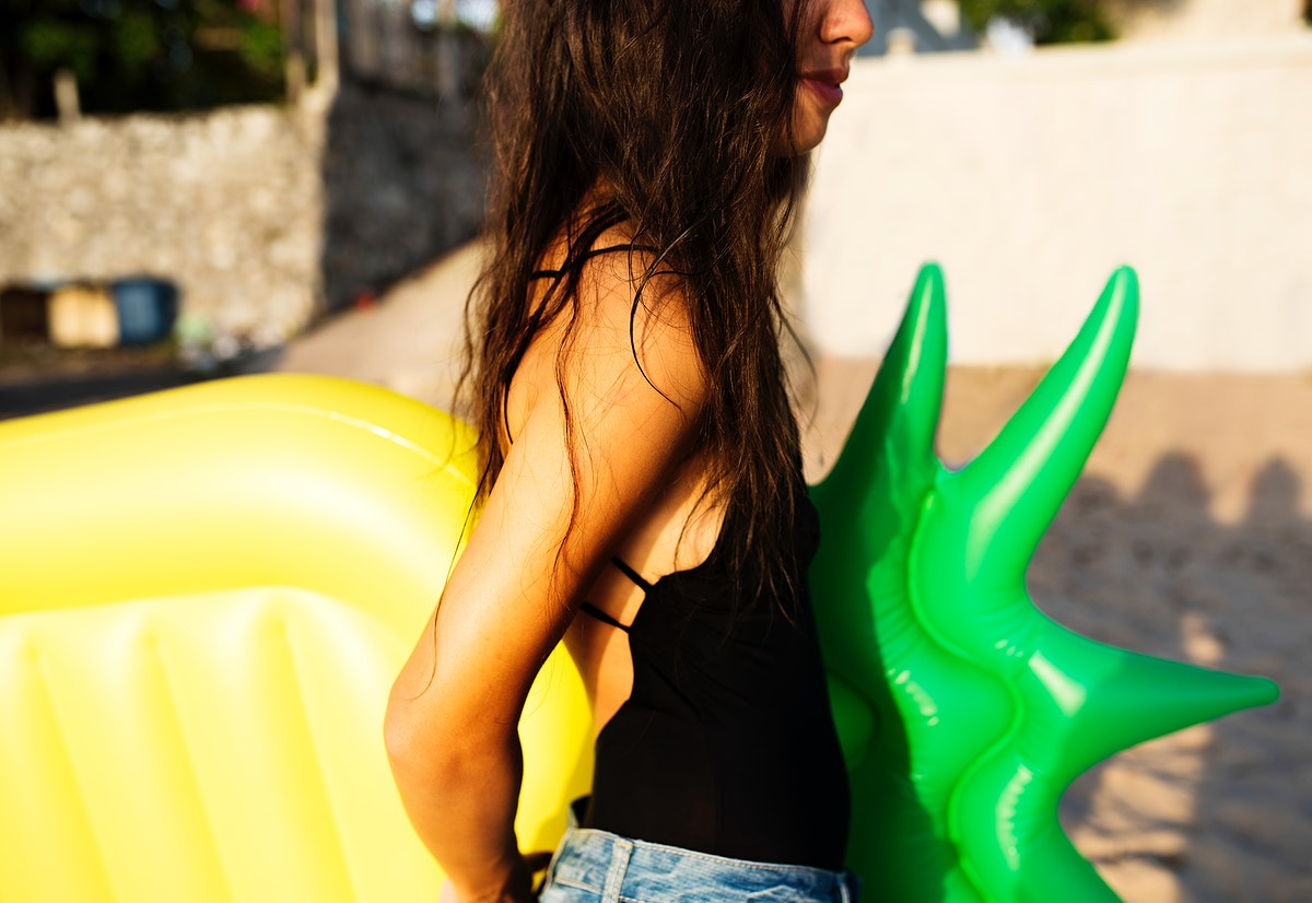 Closeup of an Asian woman with inflatable float at the beach