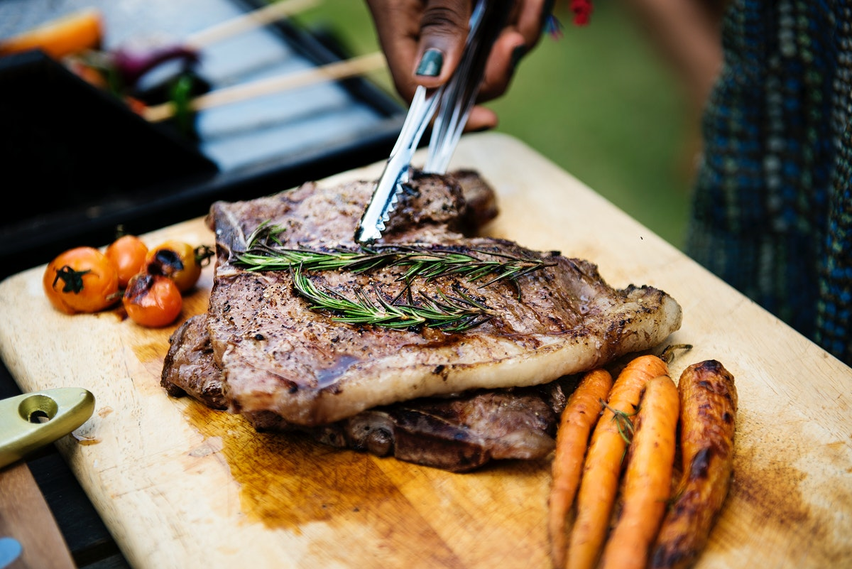 Closeup of homemade grill on a wooden table at a summer party