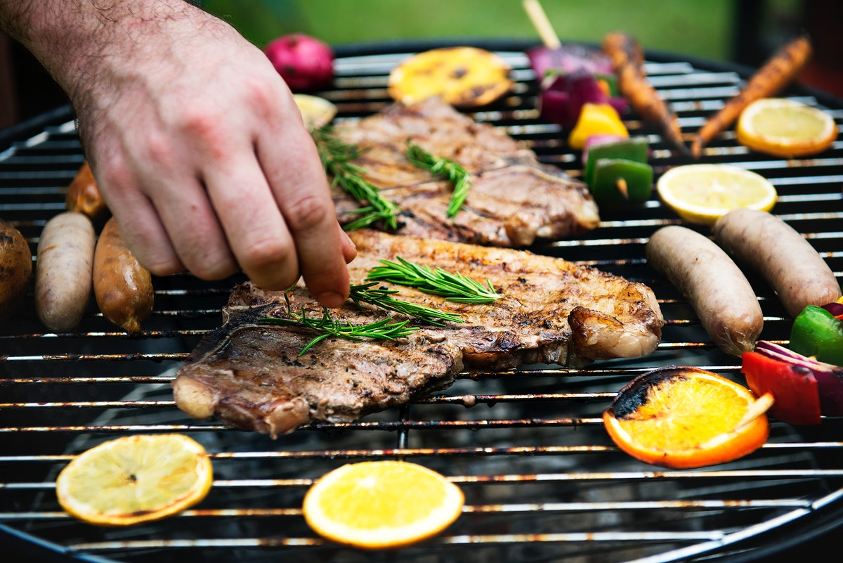 Closeup of barbecues steaks on the charcoals grill
