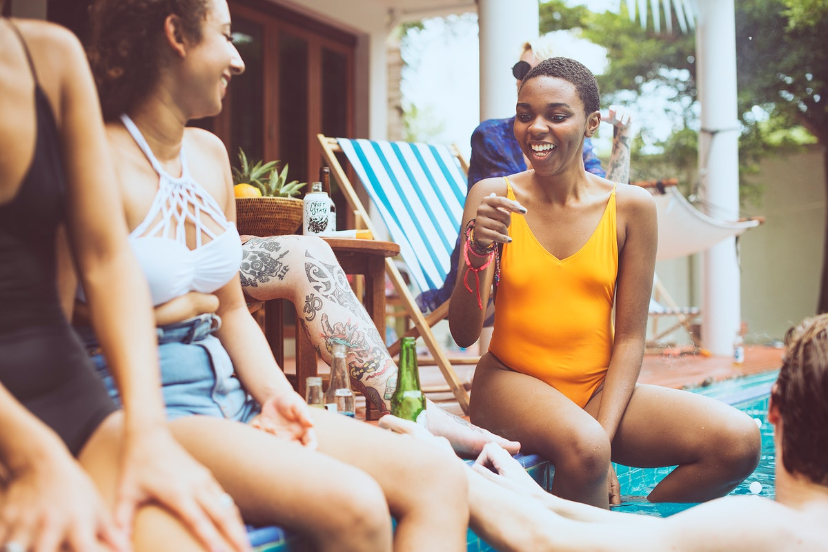 Group of diverse friends enjoying summer time together