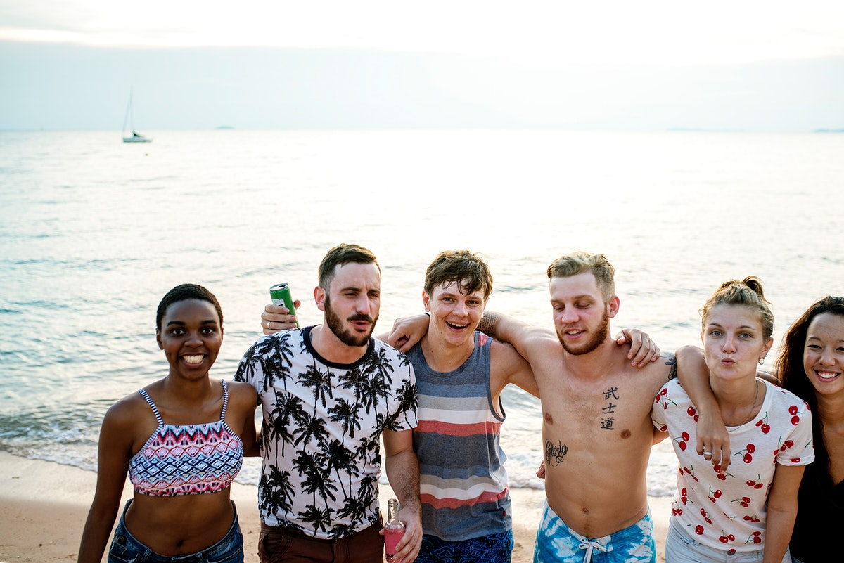 Group of diverse friends at the beach together