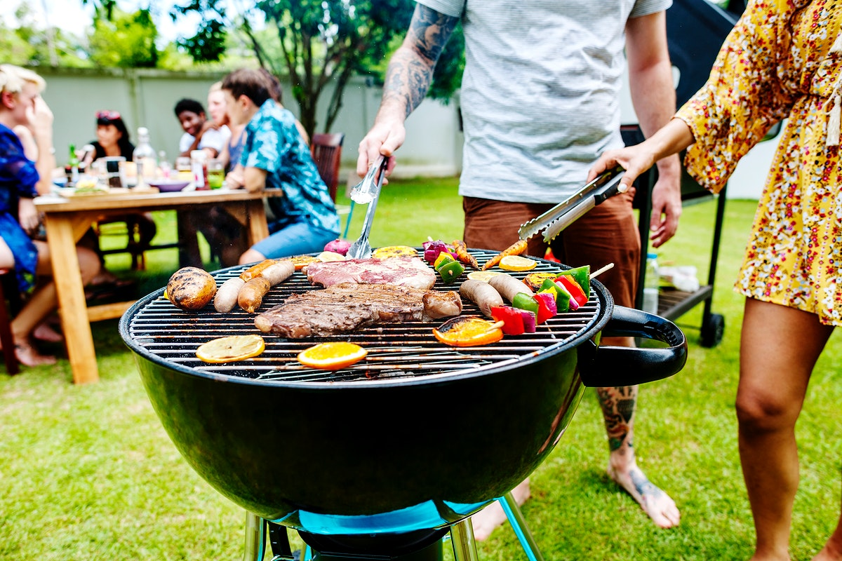 Steak barbecues cooking grilling on charcoals
