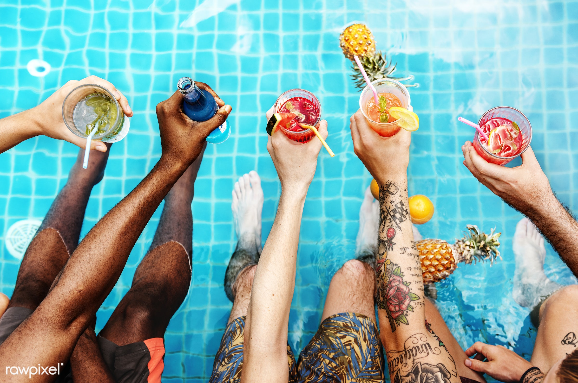 A diverse group of friends enjoying summer time with beverages in hands - pool, aerial, cheerful, diverse, enjoying, friends...