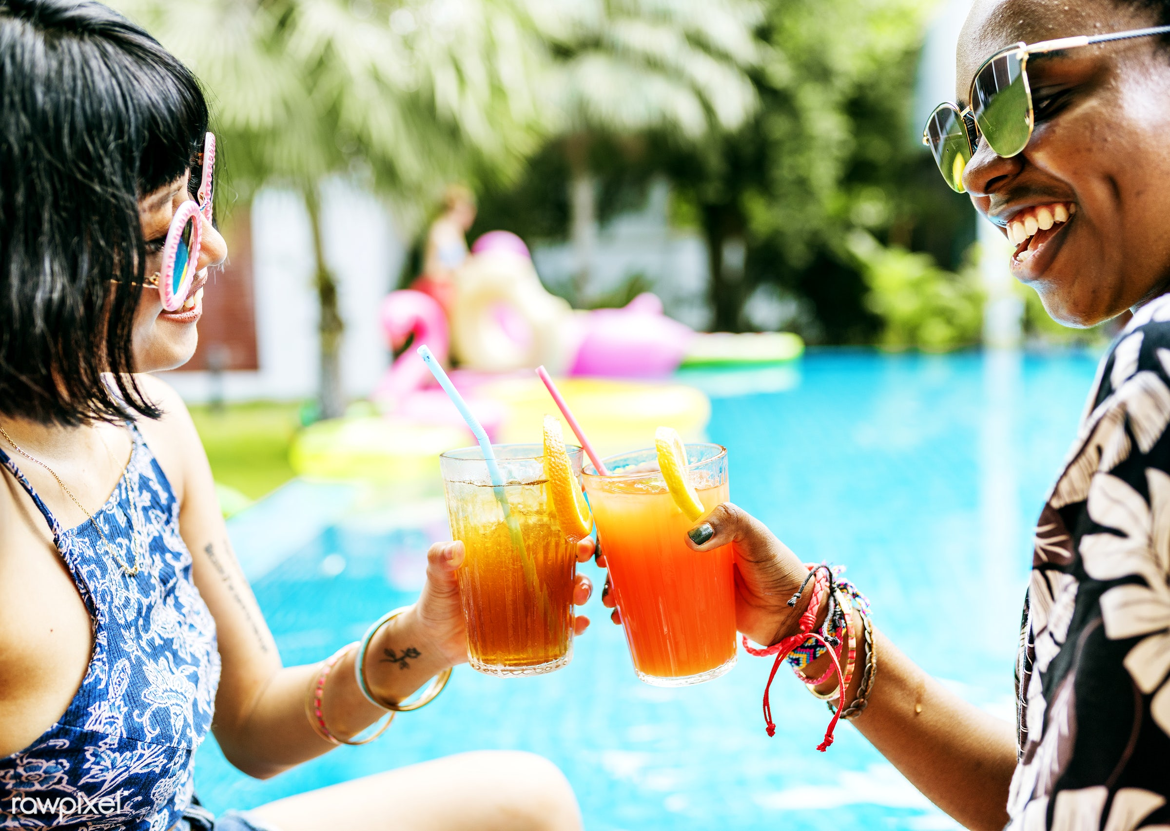 Hands toasting juice glasses by the pool summer time - fun, activity, beverage, celebration, cheerful, cheers, clink,...