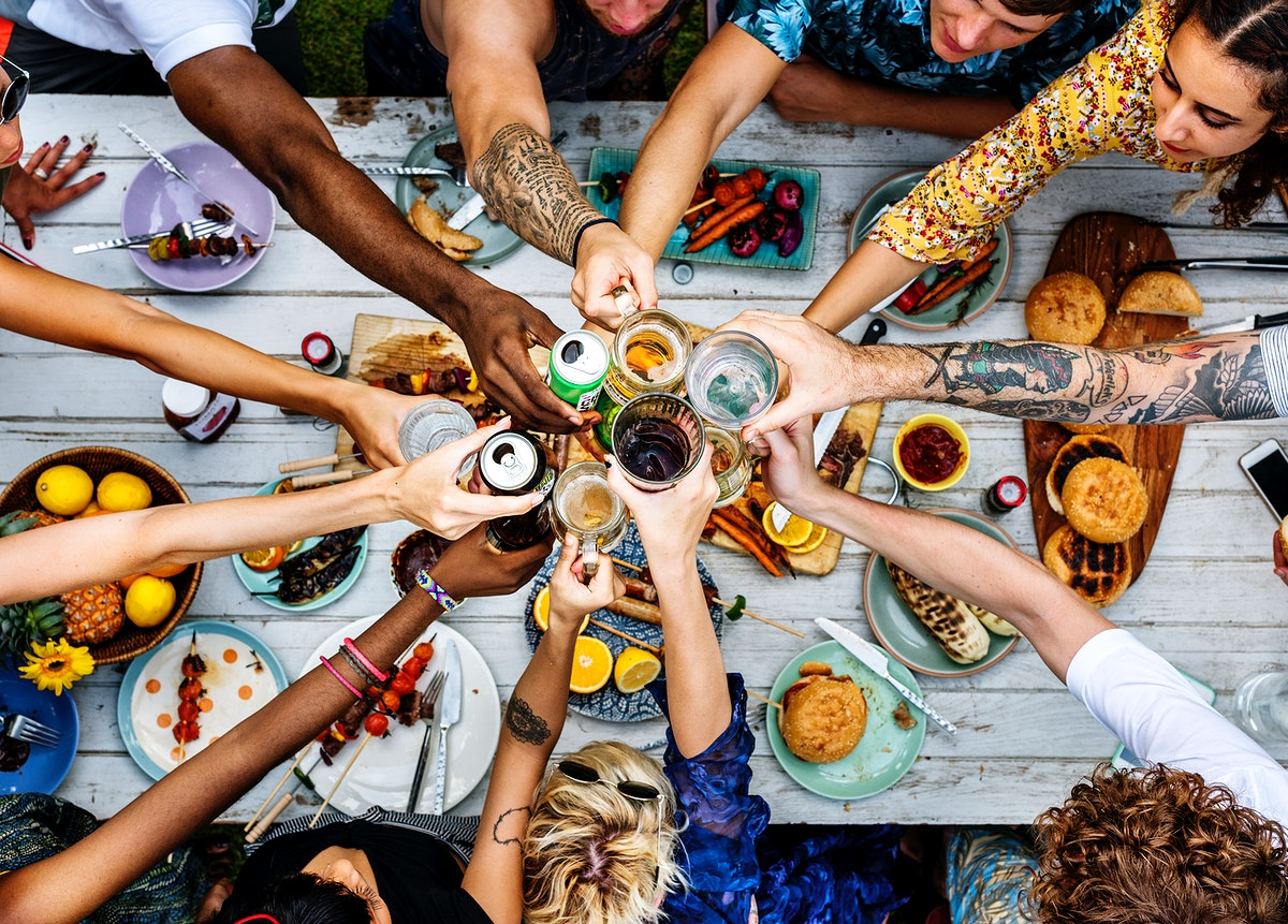 Aerial view of a diverse group of friends toasting together