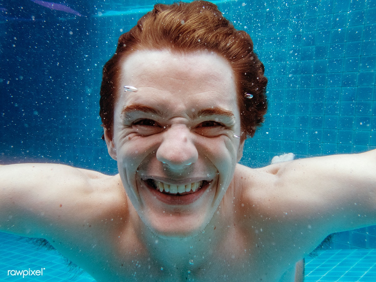 d6171e7a23b97 A caucasian man smiling underwater | Royalty free stock photo - 8024