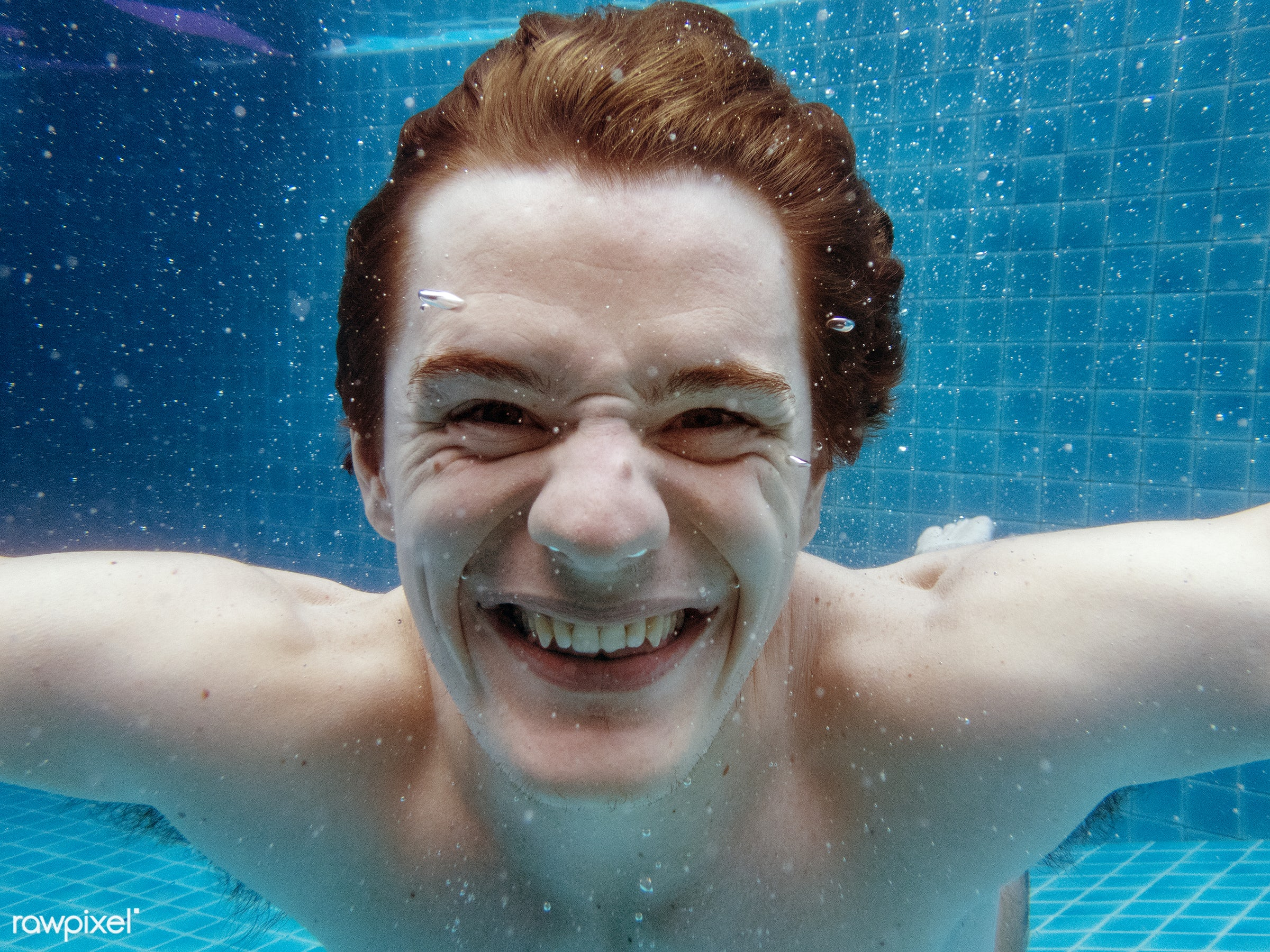 A caucasian man smiling underwater - bubbles, cheerful, chill, closeup, fun, happiness, holiday, leisure, man, outdoors,...