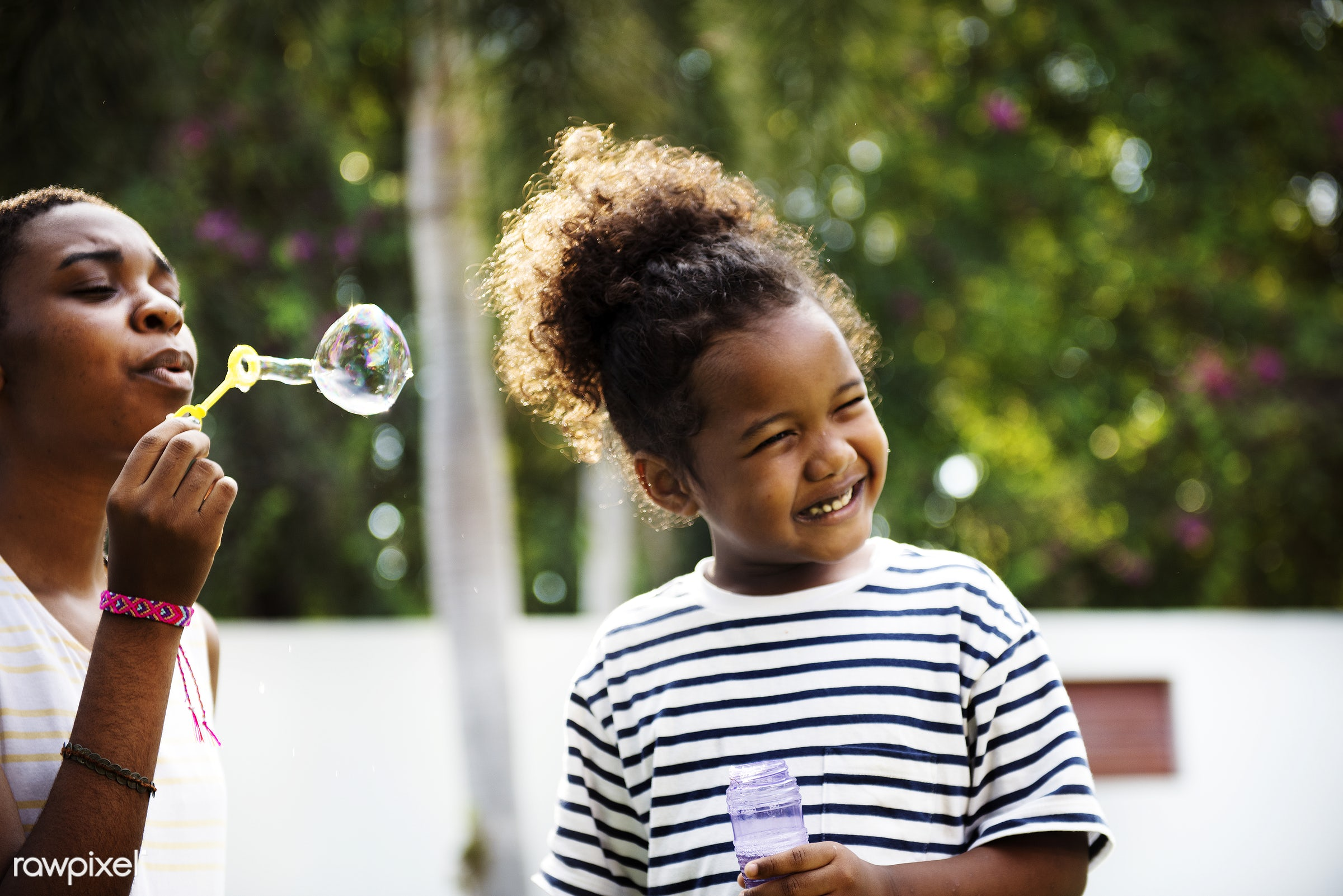 african descent, black, blowing, bubbles, cheerful, child, closeup, daughter, enjoying, family, fun, happiness, holiday, kid...