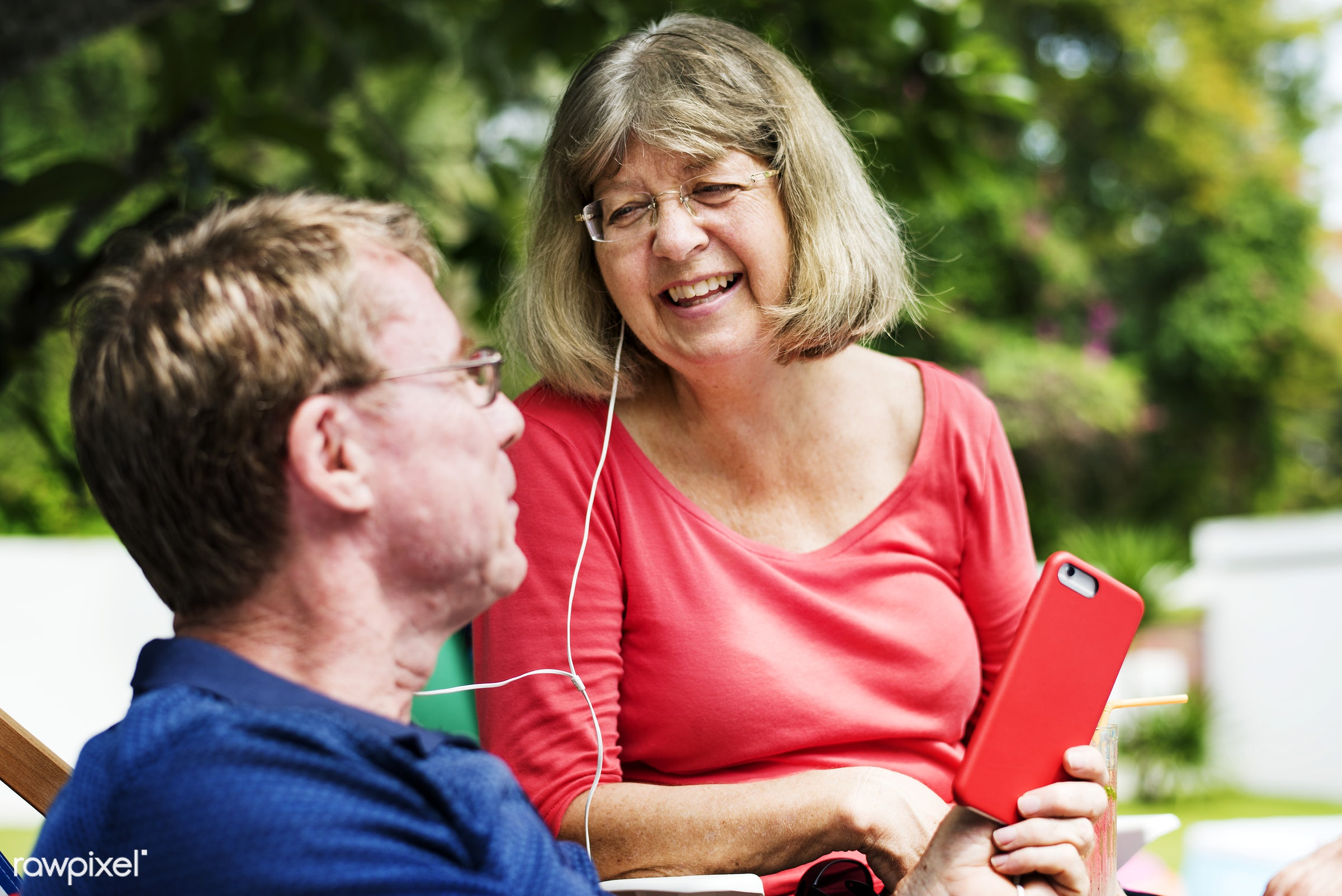 Caucasian couple listening to music together - cheerful, couple, dating, earphones, enjoying, fun, happiness, holiday,...