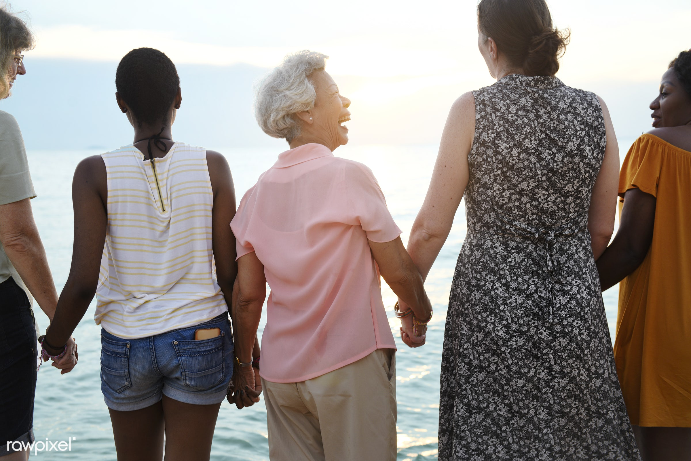 Rear view of diverse senior women holding hands together at the beach - beach, coast, together, friends, gathering,...