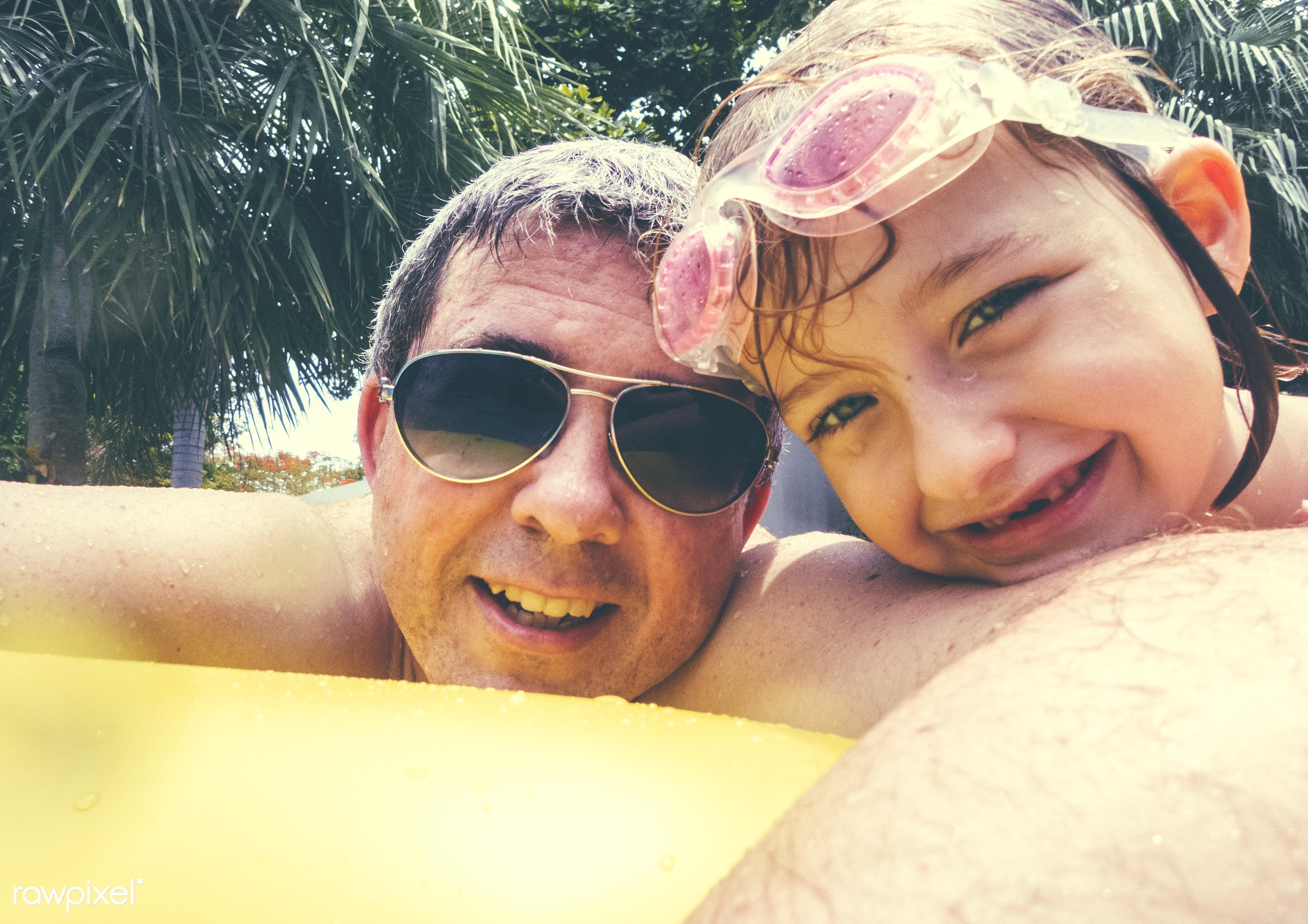 Caucasian father daughter enjoying summer time together in the pool - dad, father, family, relax, vacation, fun, cheerful,...