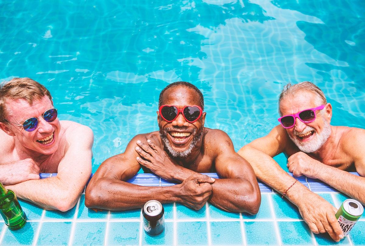 Group of diverse senior men enjoying the pool together