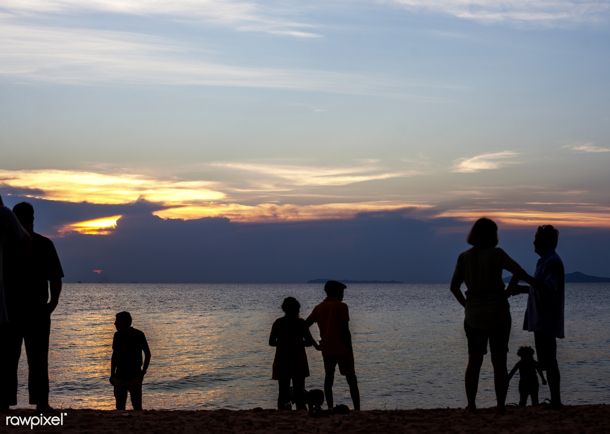 Silhouette rear view of people standing at the beach sunset together - adult, beach, cheerful, children, cloudy, coast, dawn...