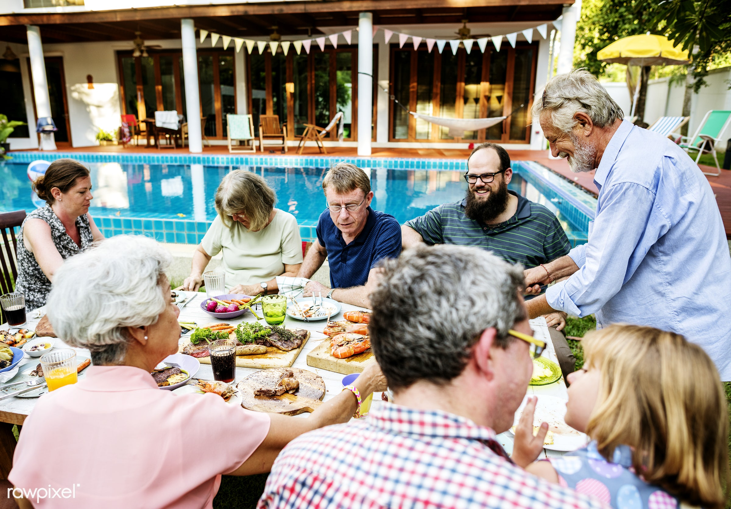 Group of diverse people enjoying barbecue party together - backyard, diverse, eating, family, food, friends, gathering,...