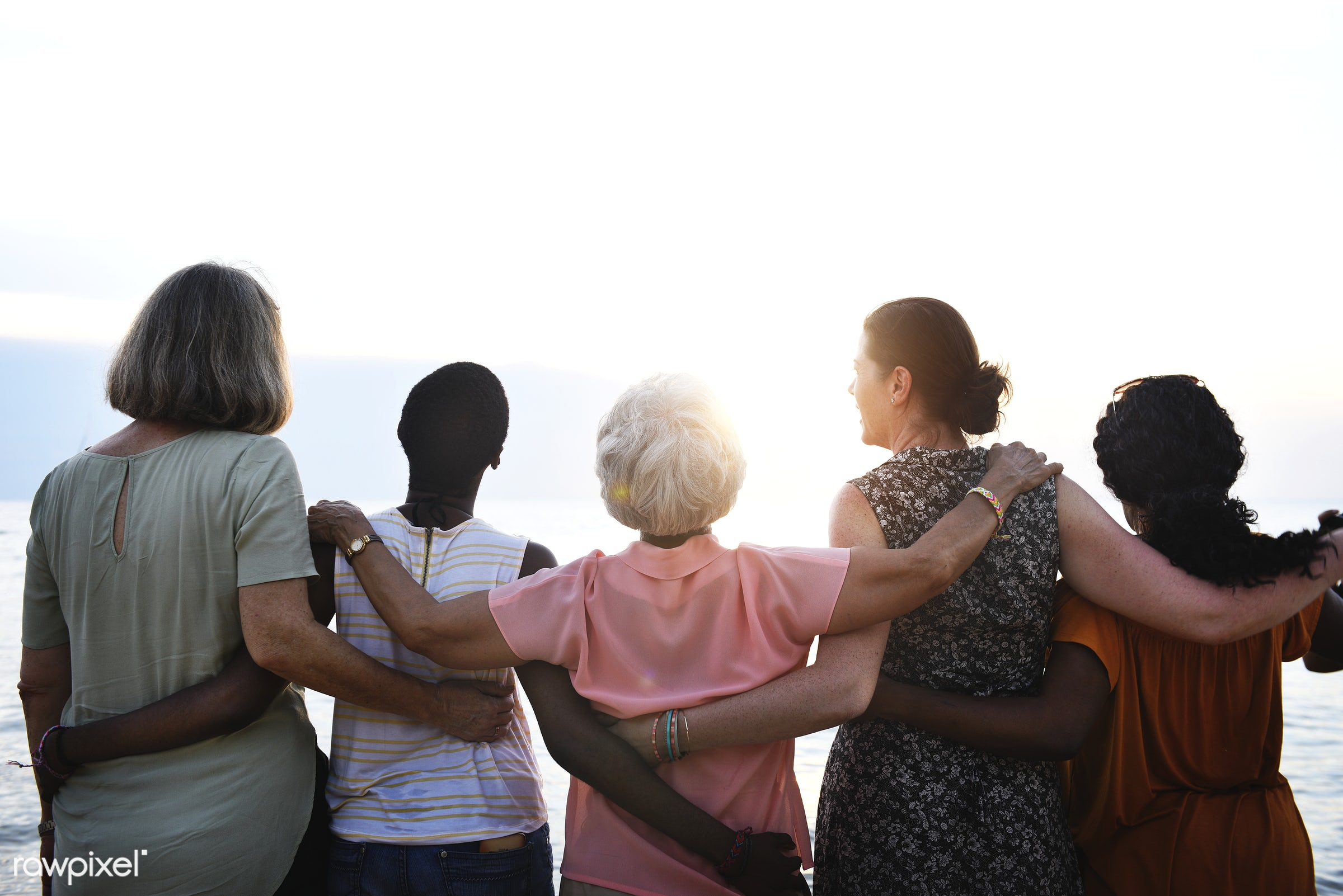 Rear view of diverse senior women standing together at the beach - beach, cheerful, coast, diversity, enjoyment, family,...