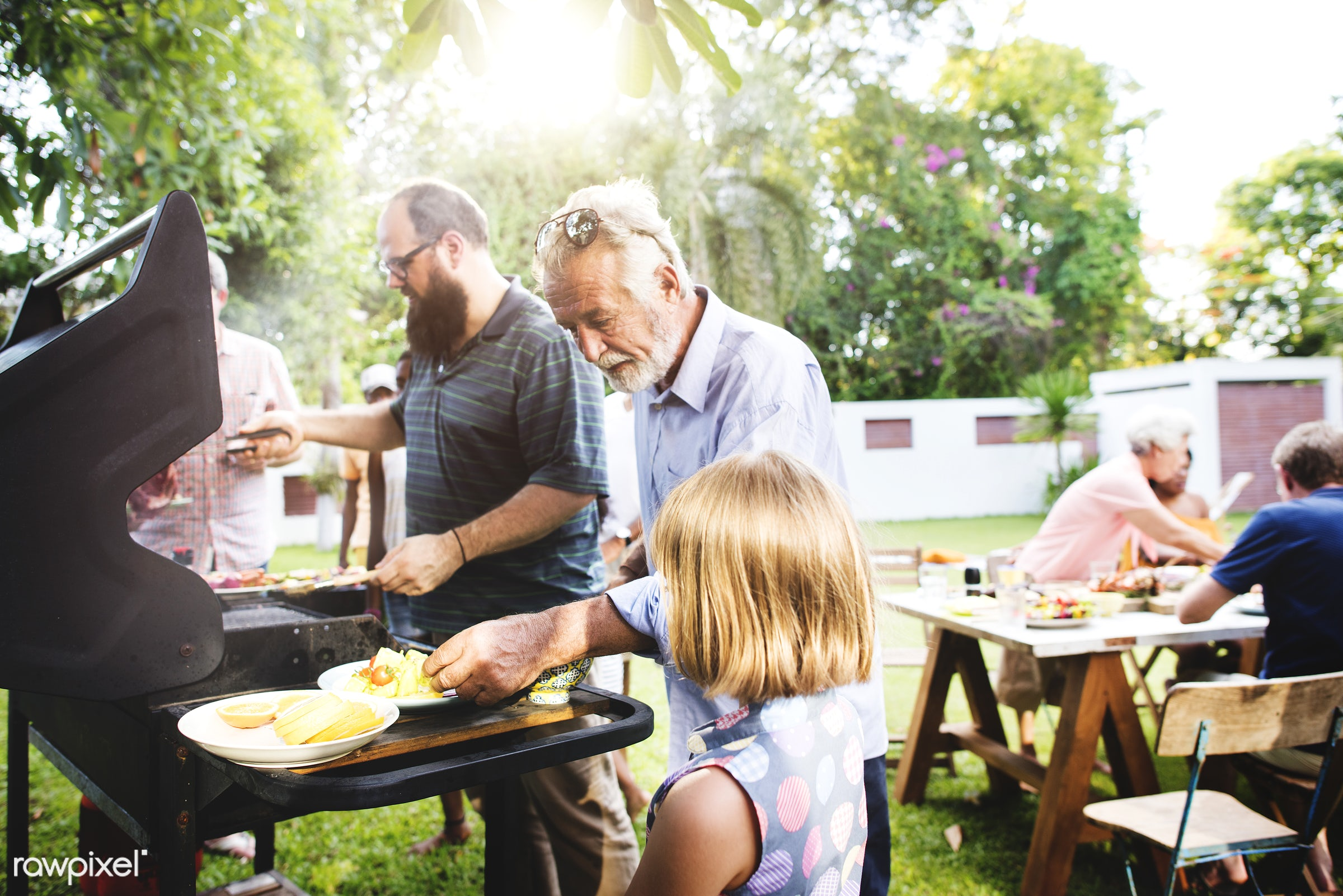 Family having a barbecue party in the yard, spending time together - bbq, grill, barbecue, charcoals, cook, cooking, cookout...