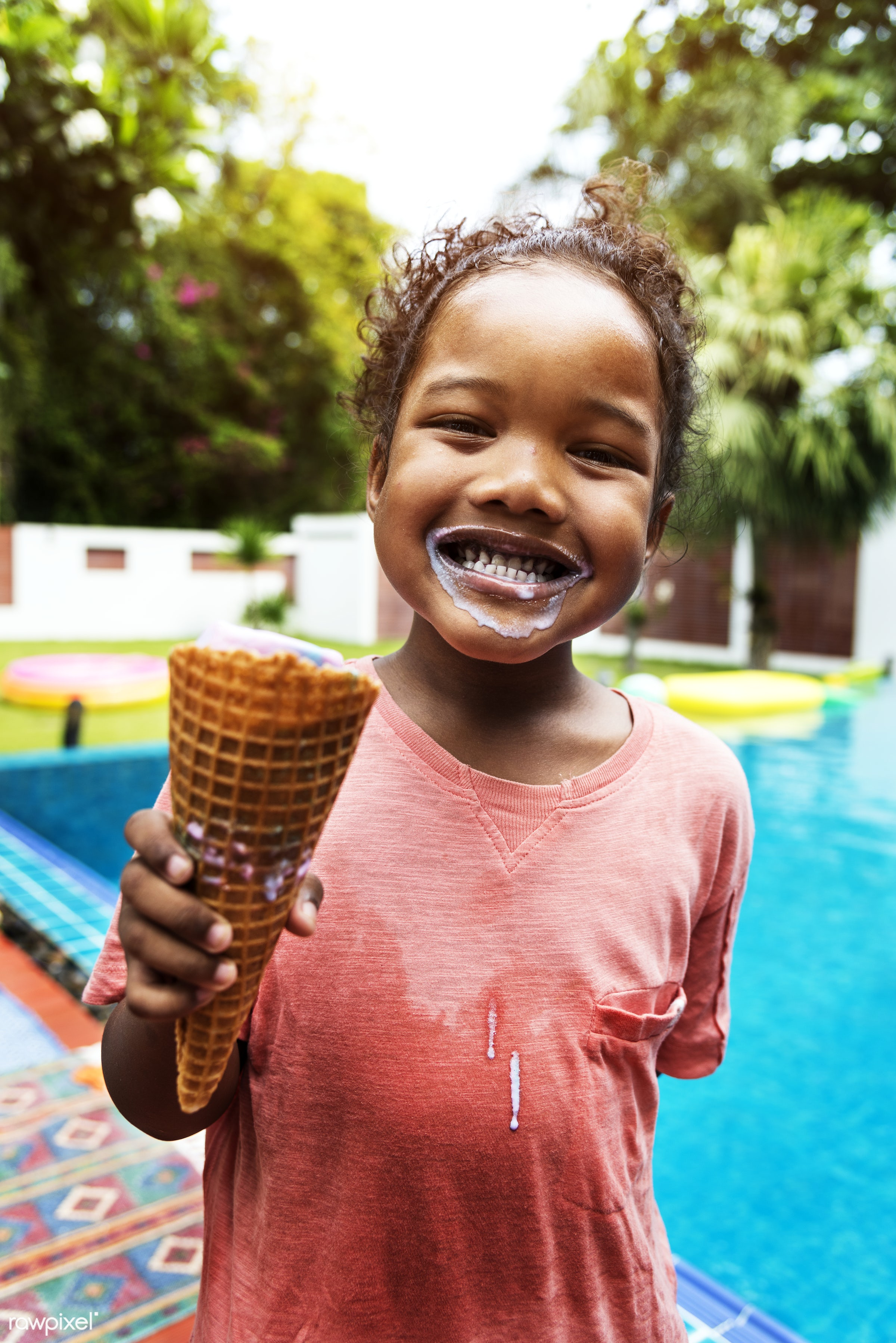 african descent, alone, black, cheerful, child, closeup, eating, enjoying, fun, girl, holiday, ice cream, kid, leisure,...
