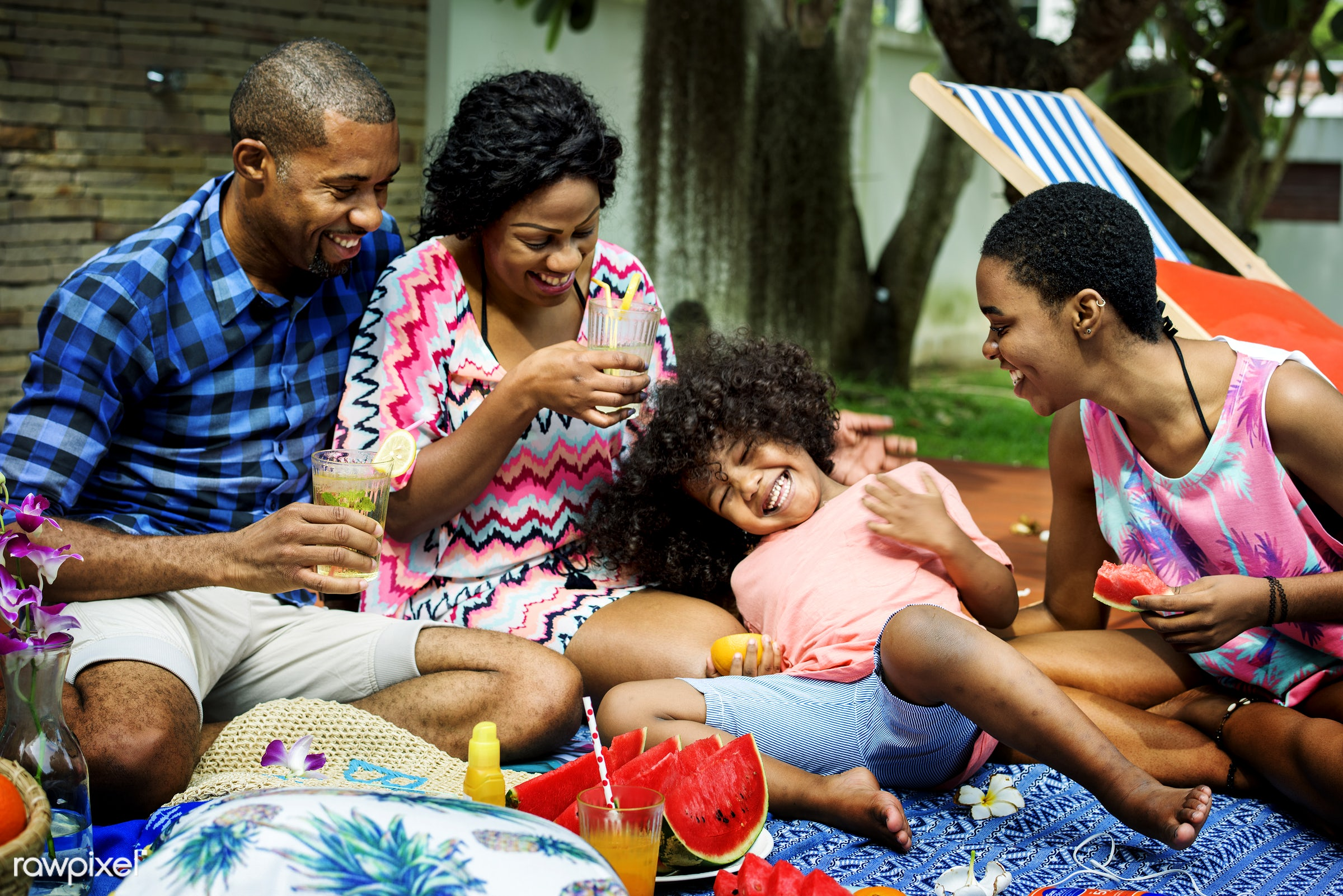Black family enjoying summer together at backyard - mom, african descent, backyard, black, cheerful, child, closeup, dad,...