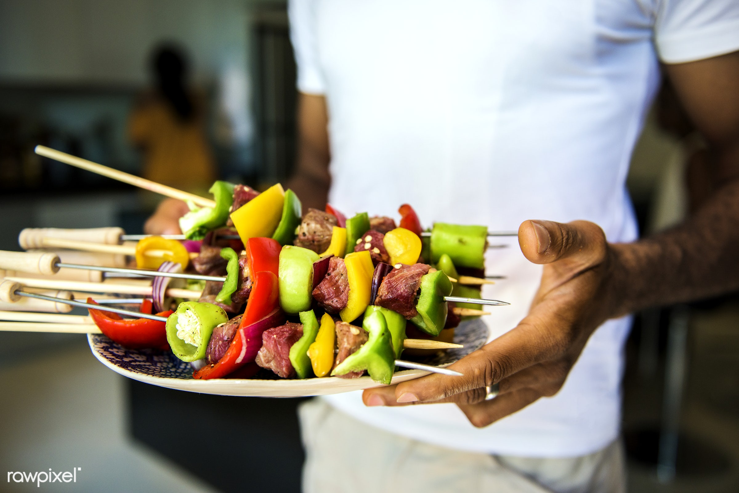 African descent man with homemade prepared barbecue - adult, african descent, barbecue, bell pepper, black, closeup, cooking...