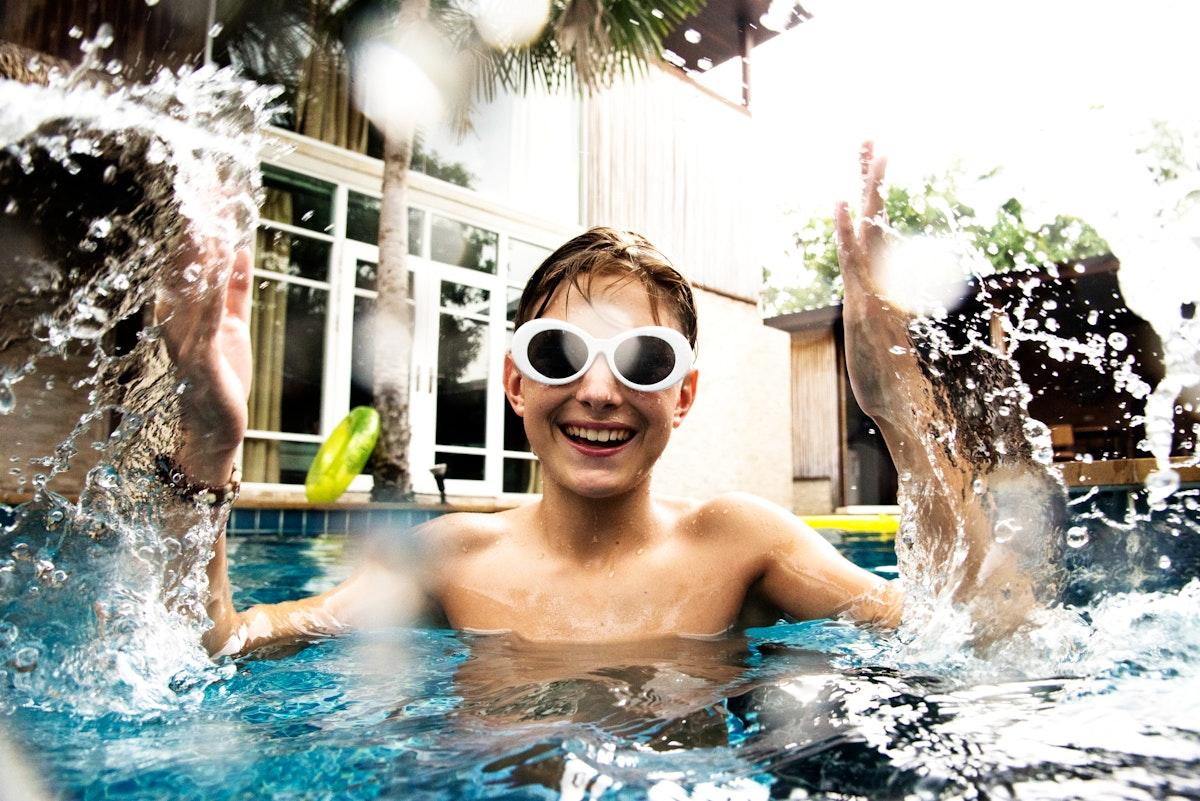Young caucasian boy enjoying the pool