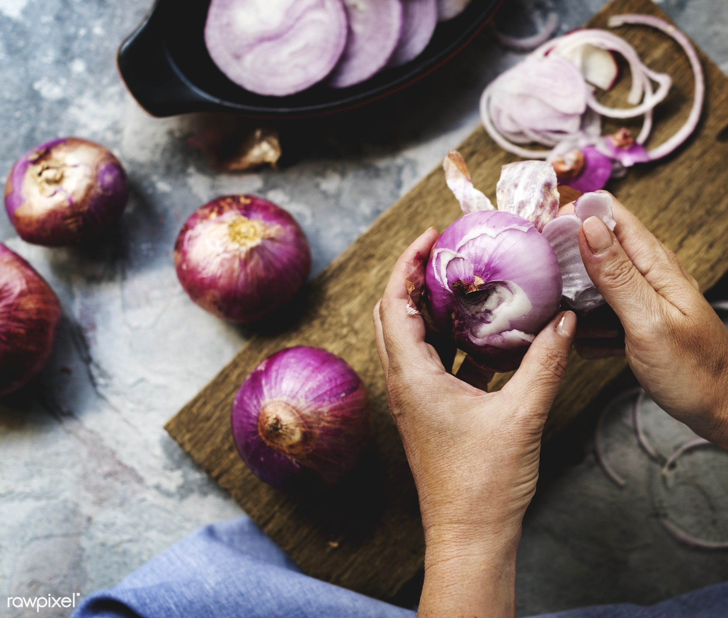 A person peeling red onion - raw, diverse, chopping board, farm, ingredients, farmer, nature, fresh, hands, products, peel,...