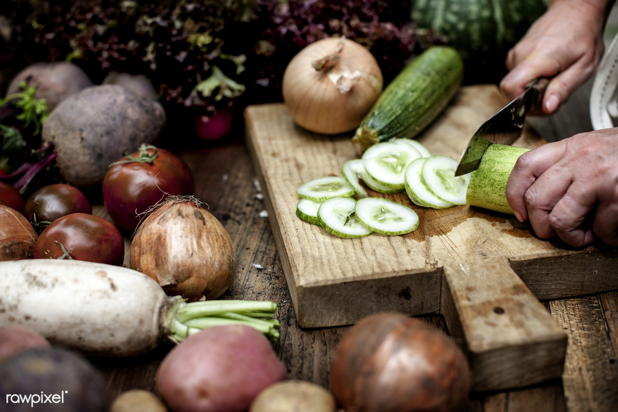 A person slicing vegetables - raw, onions, tomato, diverse, herbs, chopping board, ingredients, farm, cucumber, nature,...