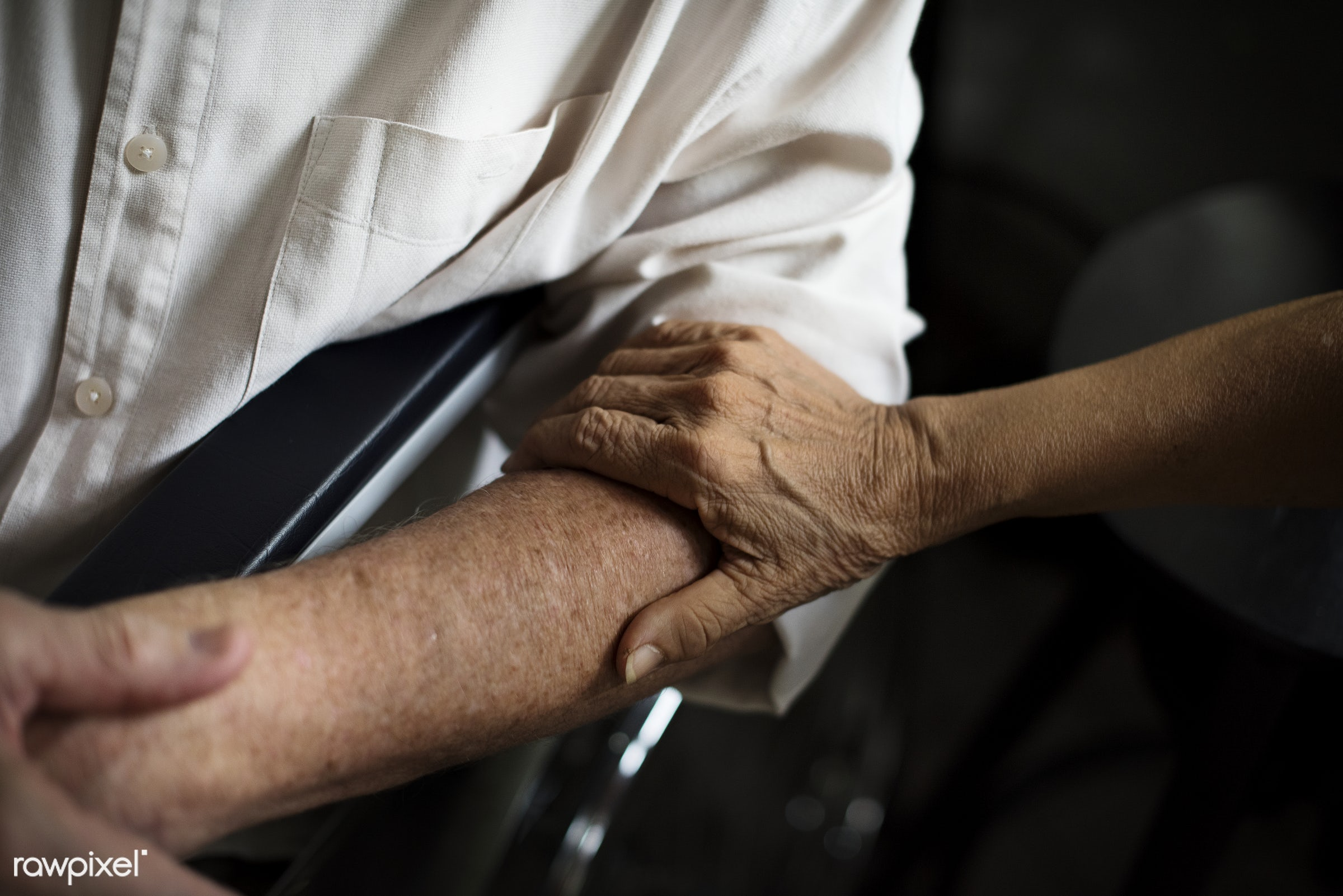 Disabled elderly on wheelchair - old, people, together, hands, wheelchair, disability, closeup, handicapped, support,...