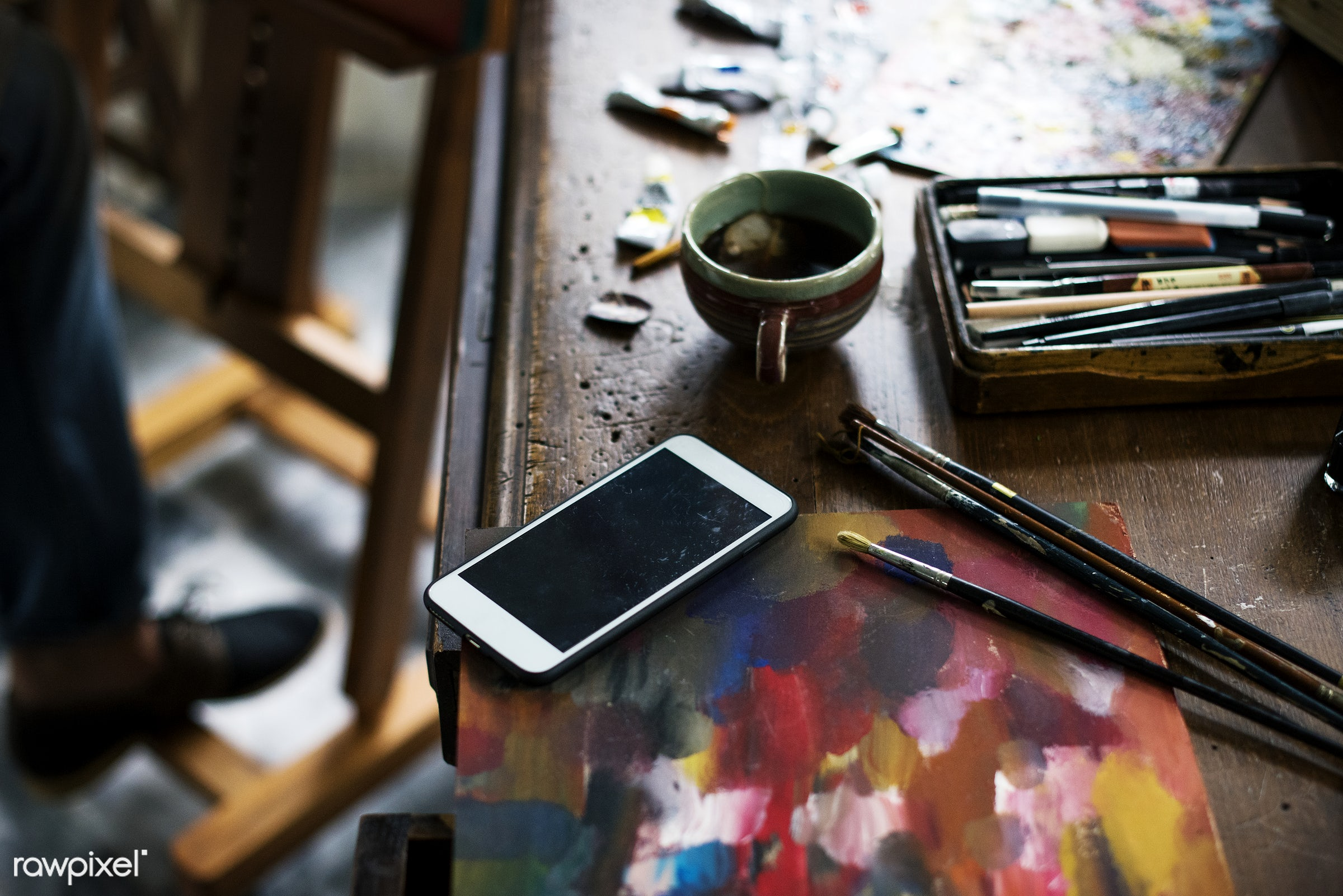 Mobile phone in artist workplace - colorful, workspace, recreation, mobile phone, painter, artist, closeup, work, creative,...