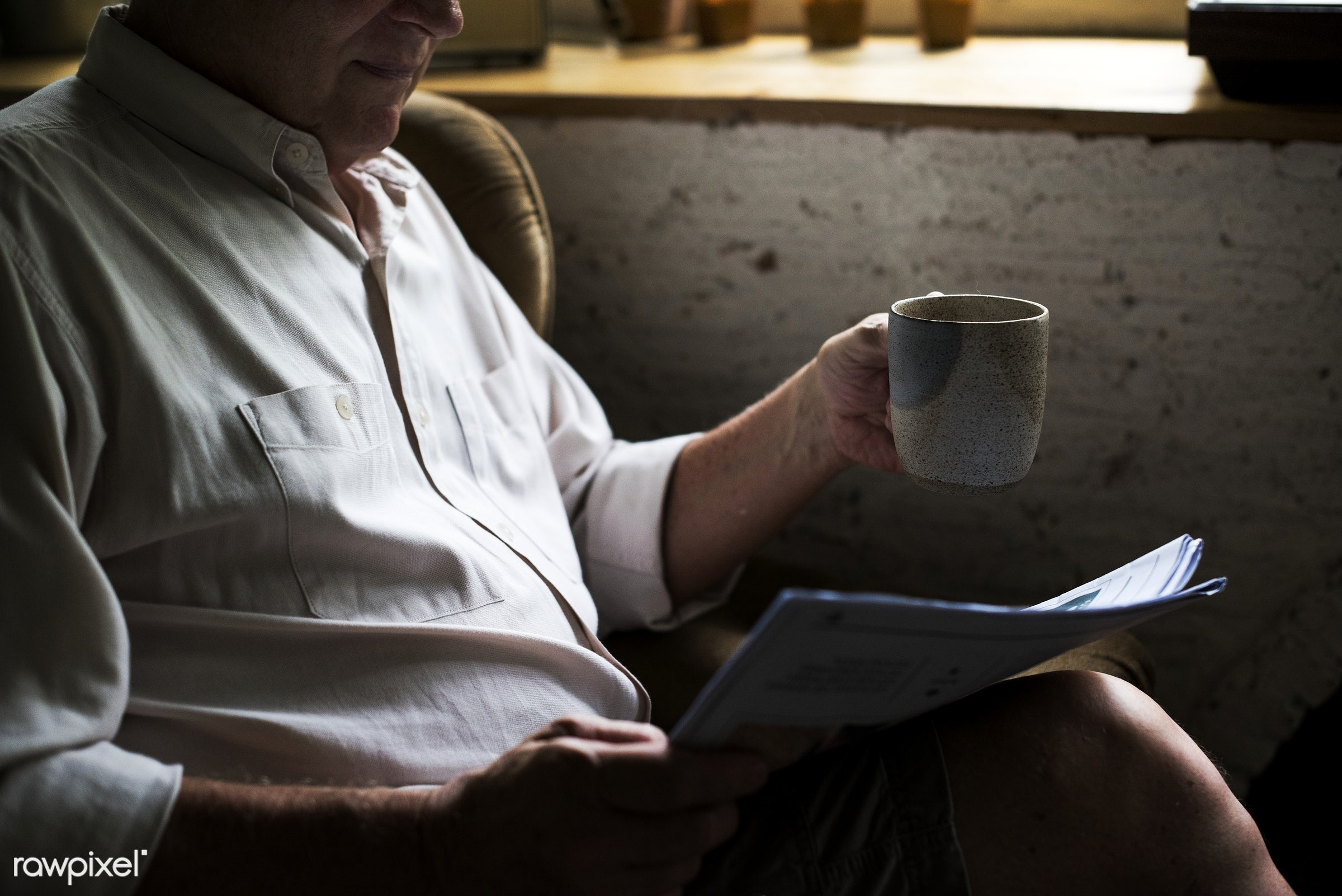 cup, relax, holding, indoors, house, hands, side, living room, read, alone, closeup, man, hobby, leisure, sitting, elderly,...