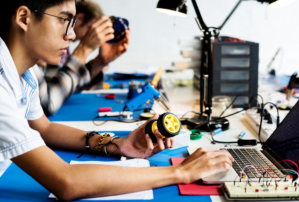 Technician working on robot programming