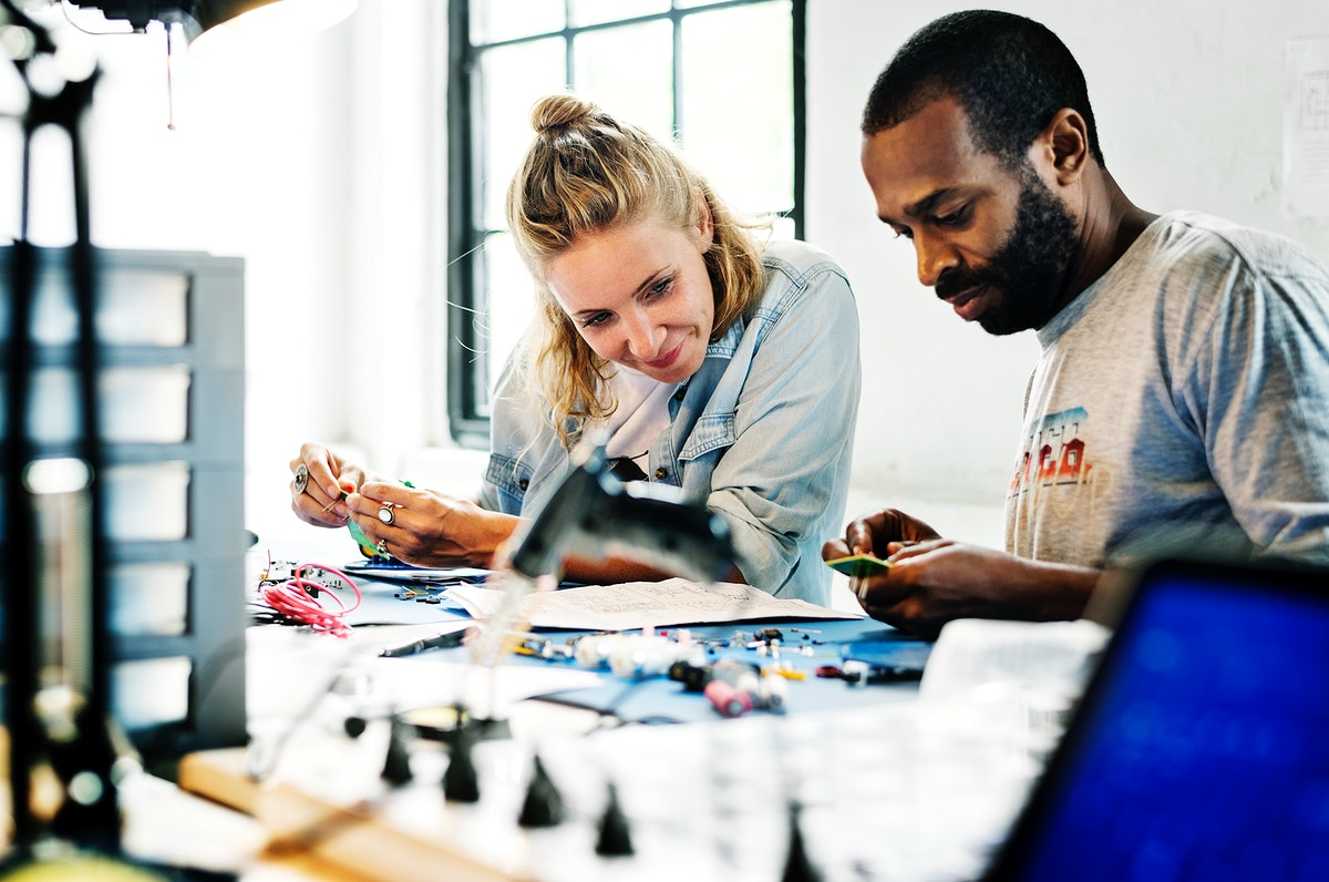 Technicians working on electronics parts