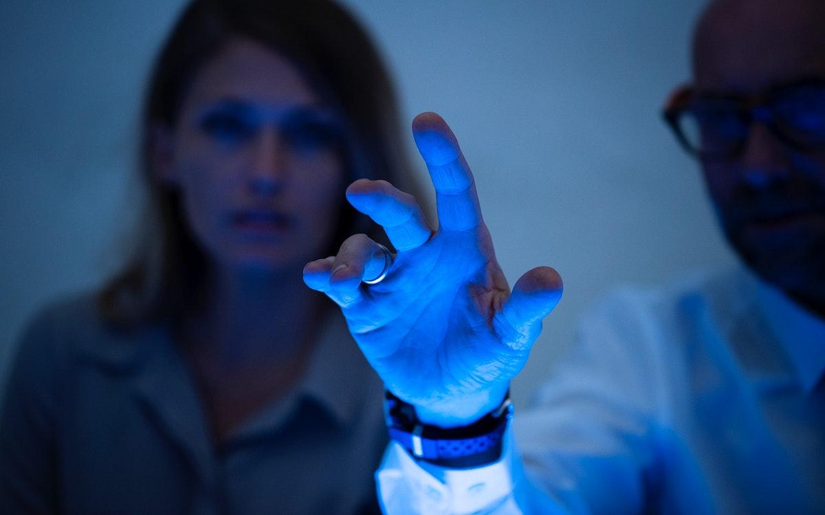 Man touching a virtual screen