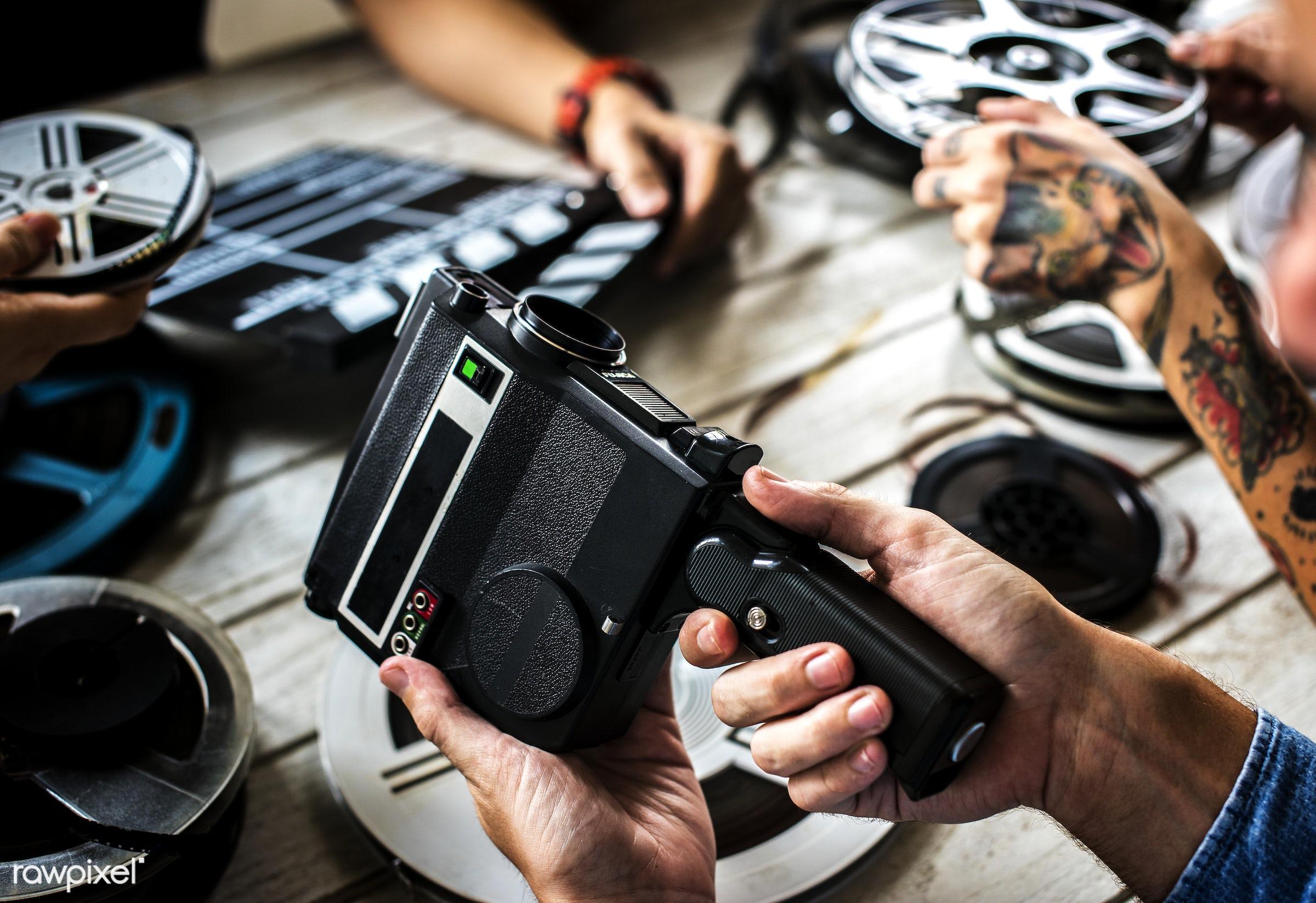 Vintage film camera - action, antique, camera, cinema, equipment, film, film strip, hands, industry, movie, old, recorder,...