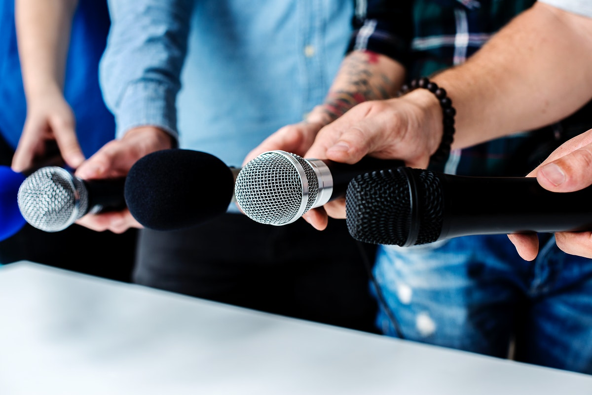 Hands holding microphone for an interview
