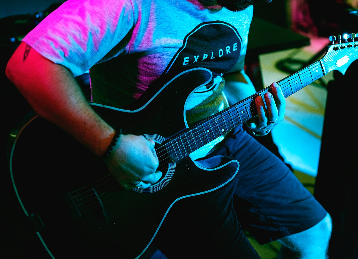 Man playing guitar in an event
