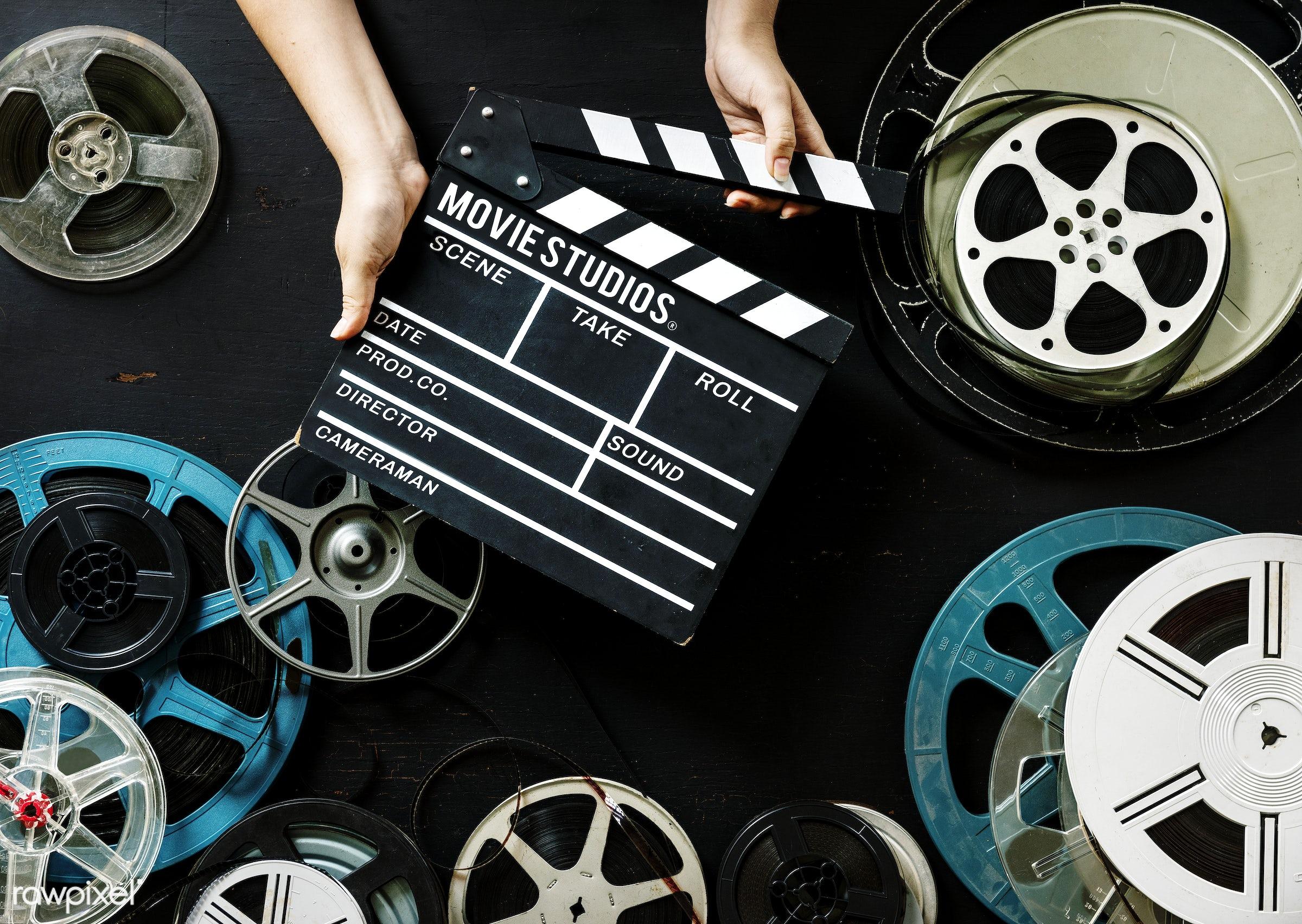 Hand hold a film strip - movie, video, cinema, action, analog, antique, entertainment, equipment, film, film strip, hands,...