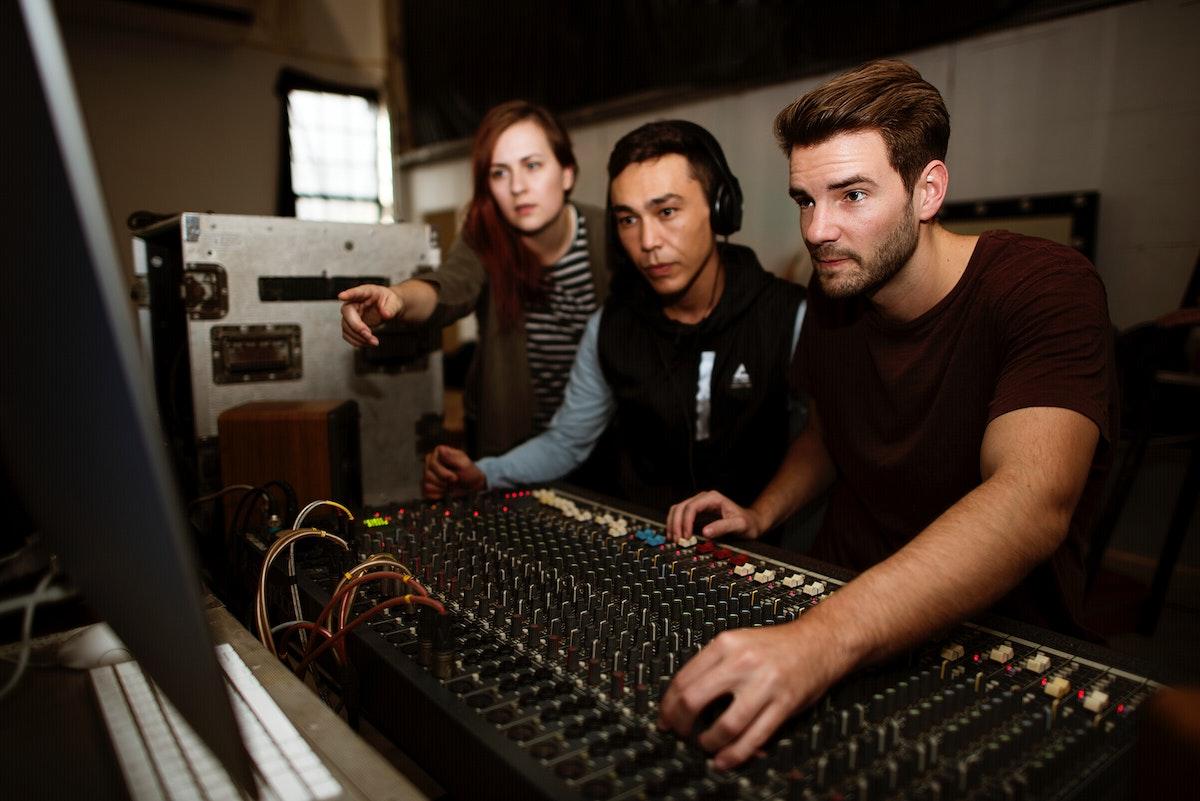 Sound engineer team check a sound on mixer