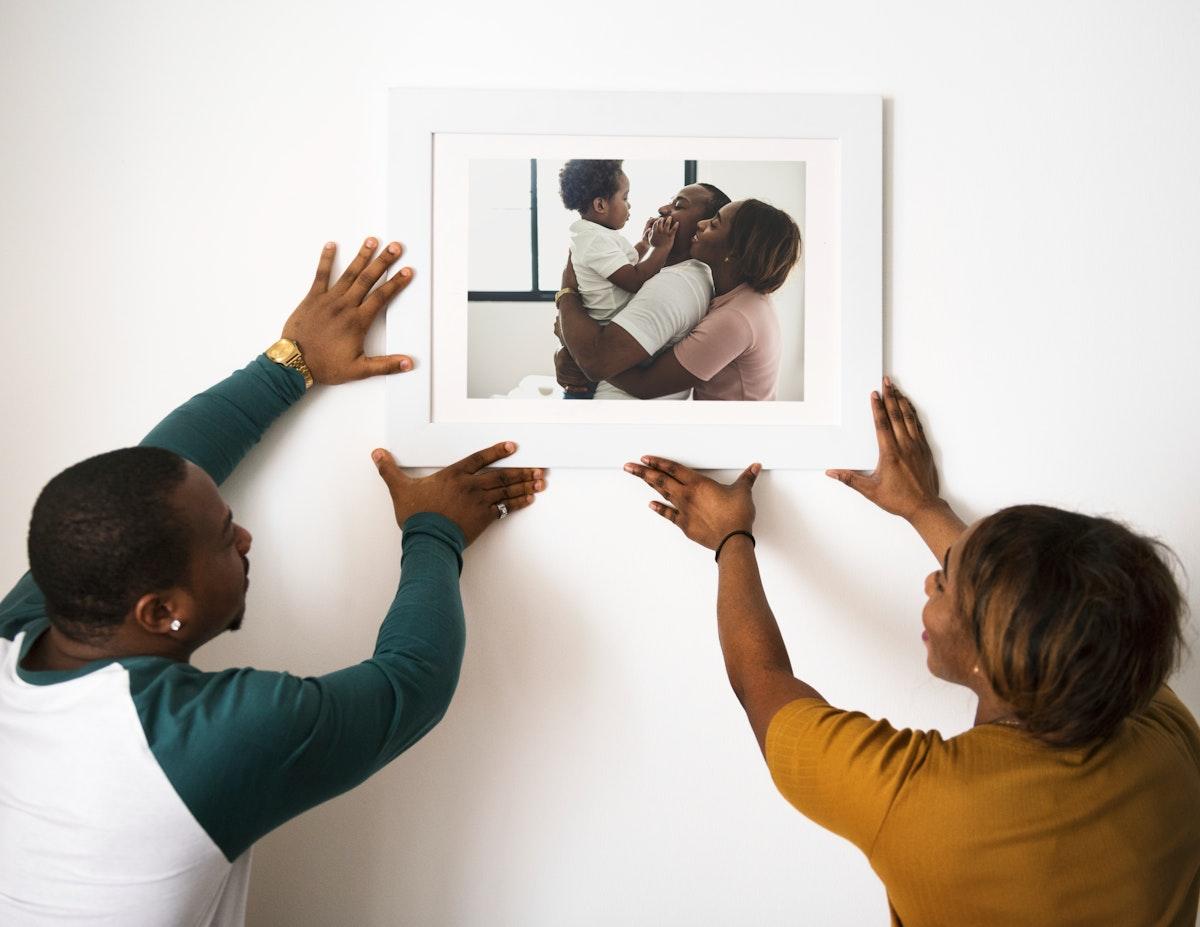 Black couple hanging fmily photo
